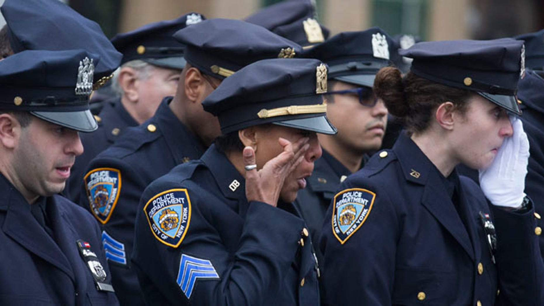 Jan. 4, 2015: Police officers at funeral for New York police Officer Wenjian Liu at Aievoli Funeral Home, Brooklyn, N.Y.