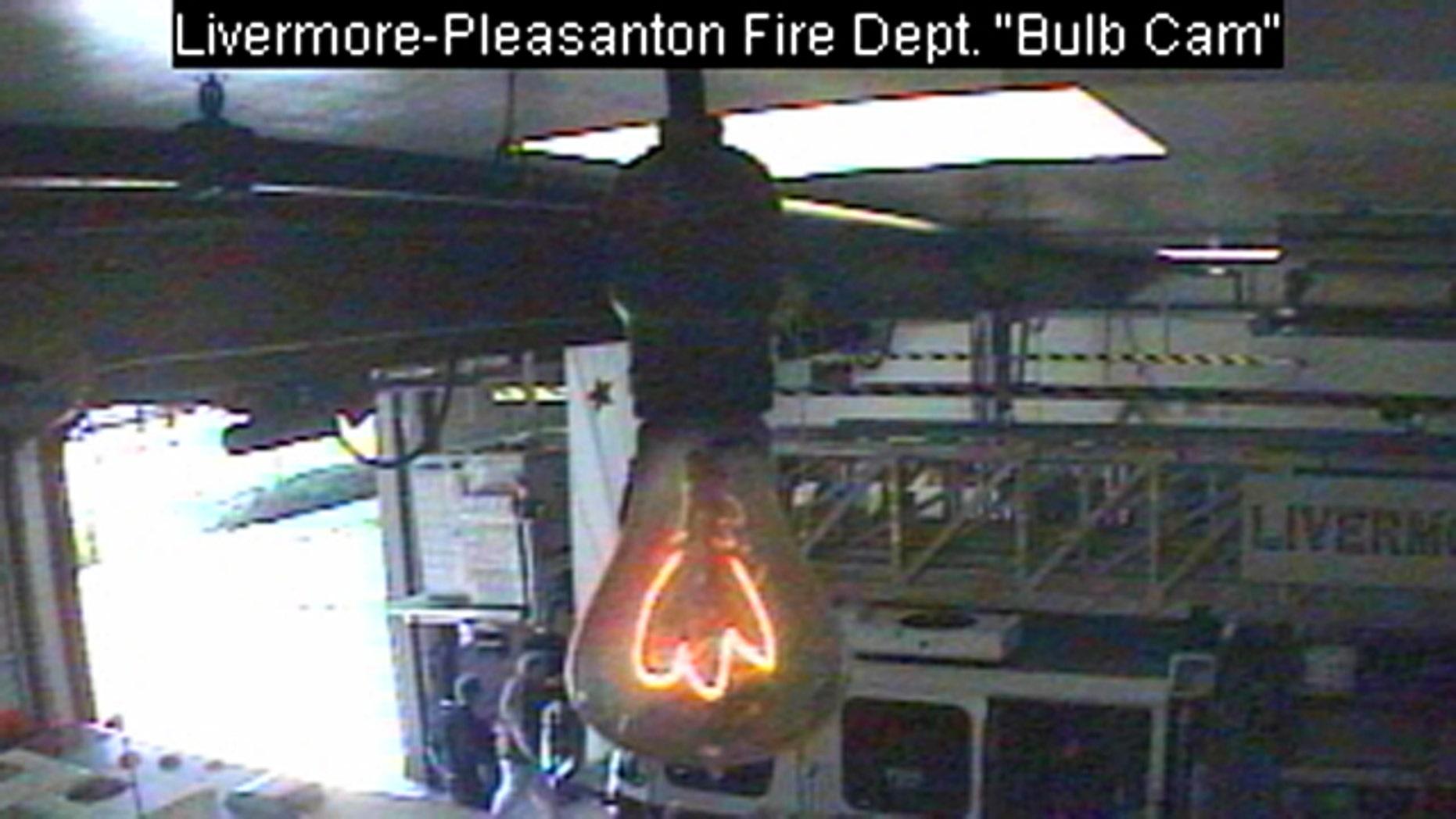 A frame from the Livermore-Pleasanton Dire Department's bulbcam shows the oldest lightbulb in the world, still glowing after all these years.