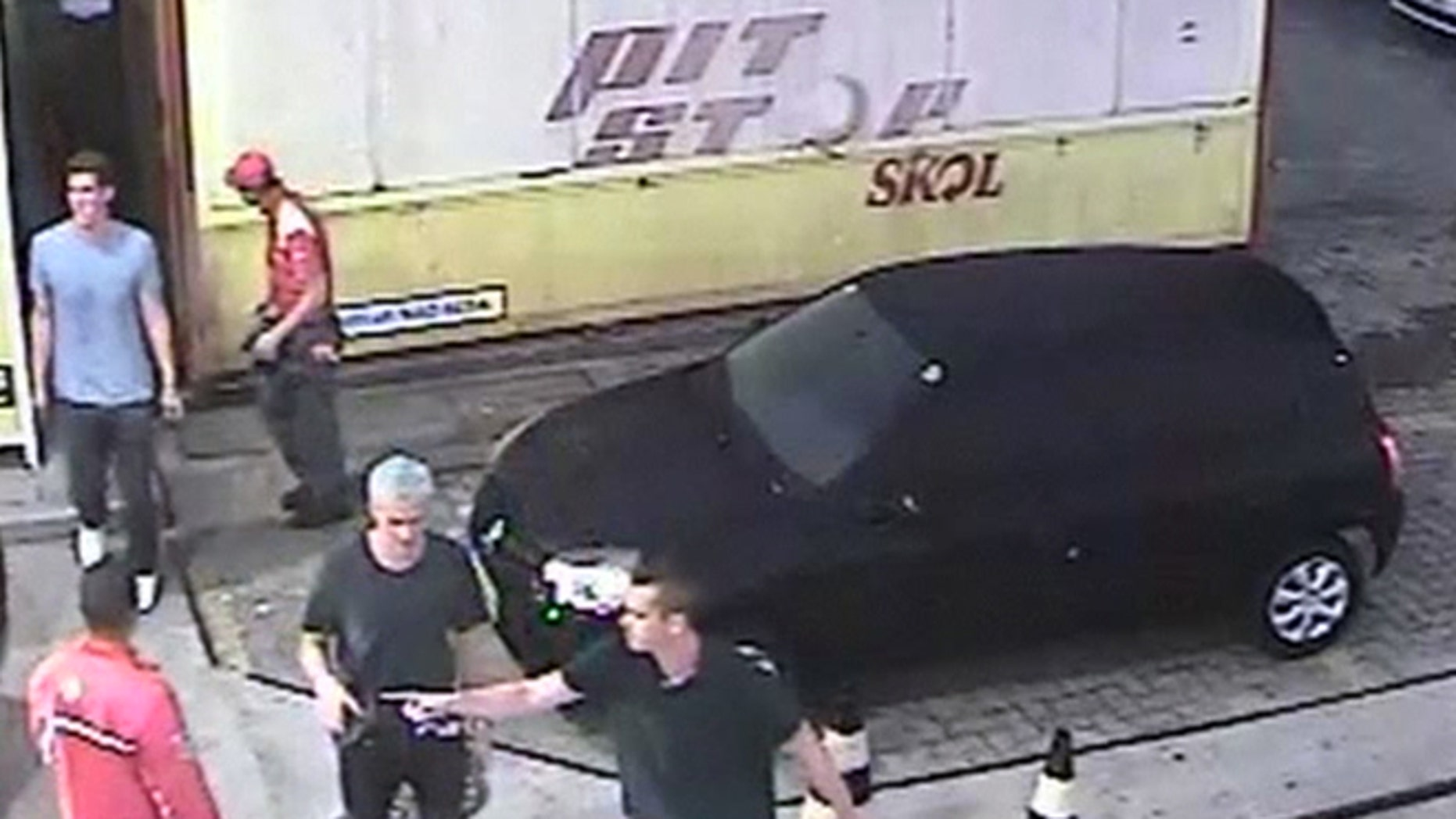 In this Sunday, Aug. 14, 2016 frame from surveillance video released by Brazil Police, swimmer Ryan Lochte, second from right, of the United States, and teammates, appear at a gas station during the 2016 Summer Olympics in Rio de Janeiro, Brazil. A top Brazil police official said the swimmers damaged property at the gas station. (Brazil Police via AP)