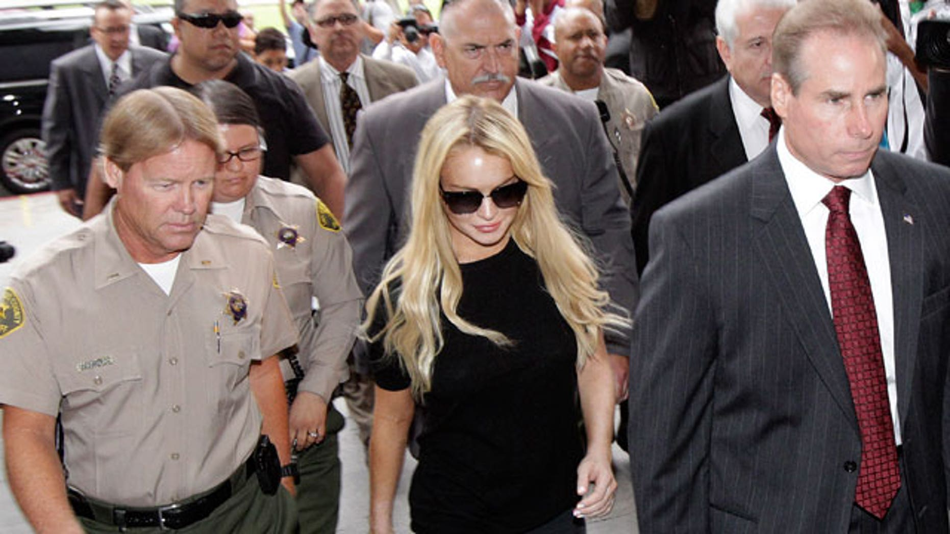 July 6: Lindsay Lohan arrives for a probation hearing in Los Angeles.