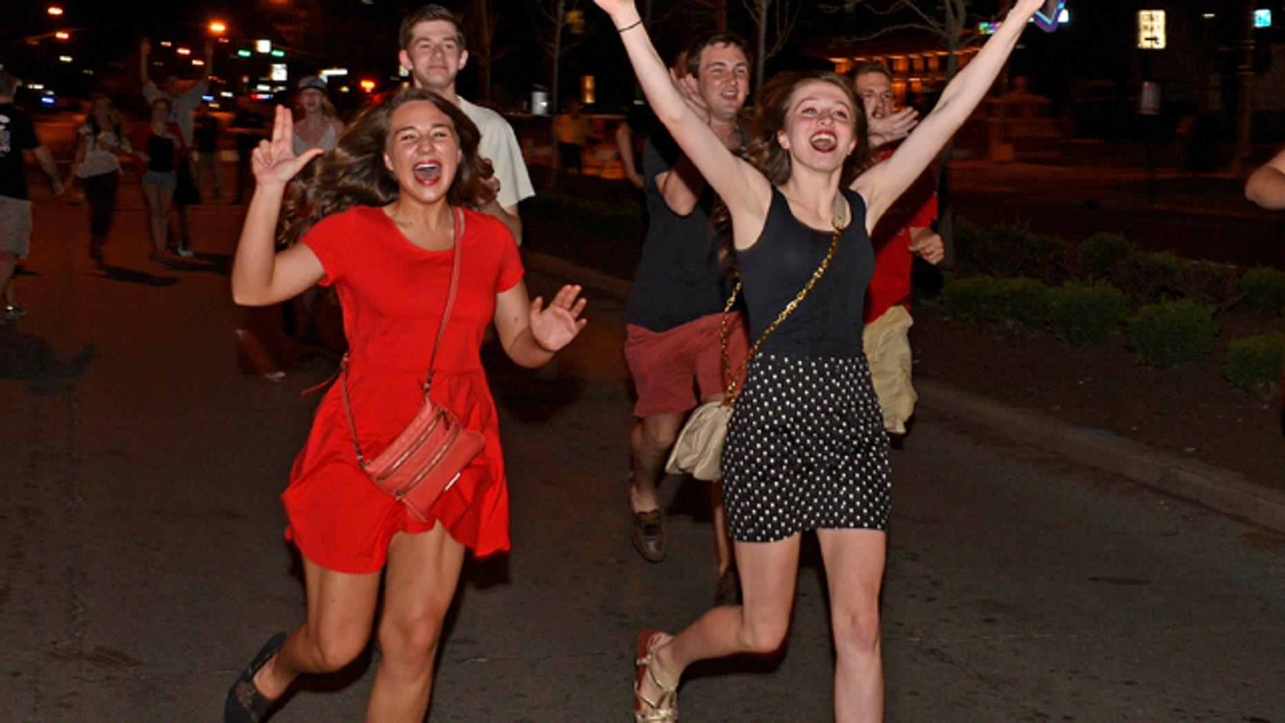 April 8, 2013: Louisville fans celebrate following their 82-76 victory in the 2013 NCAA Men's National Basketball Championship game.