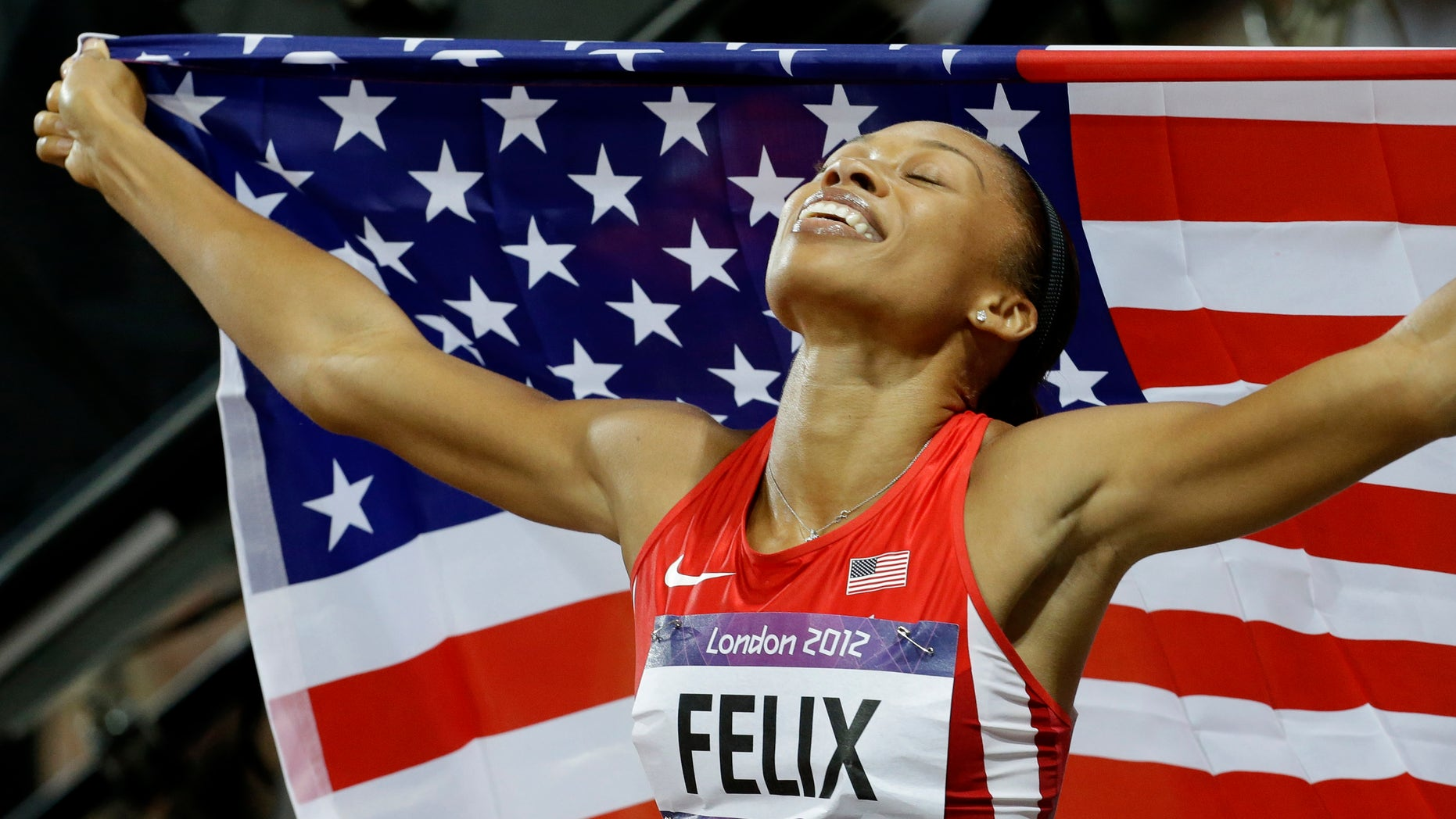 United States' Allyson Felix celebrates her in win the women's 200-meters during the athletics in the Olympic Stadium at the 2012 Summer Olympics, London, Wednesday, Aug. 8, 2012. (AP Photo/Lee Jin-man)