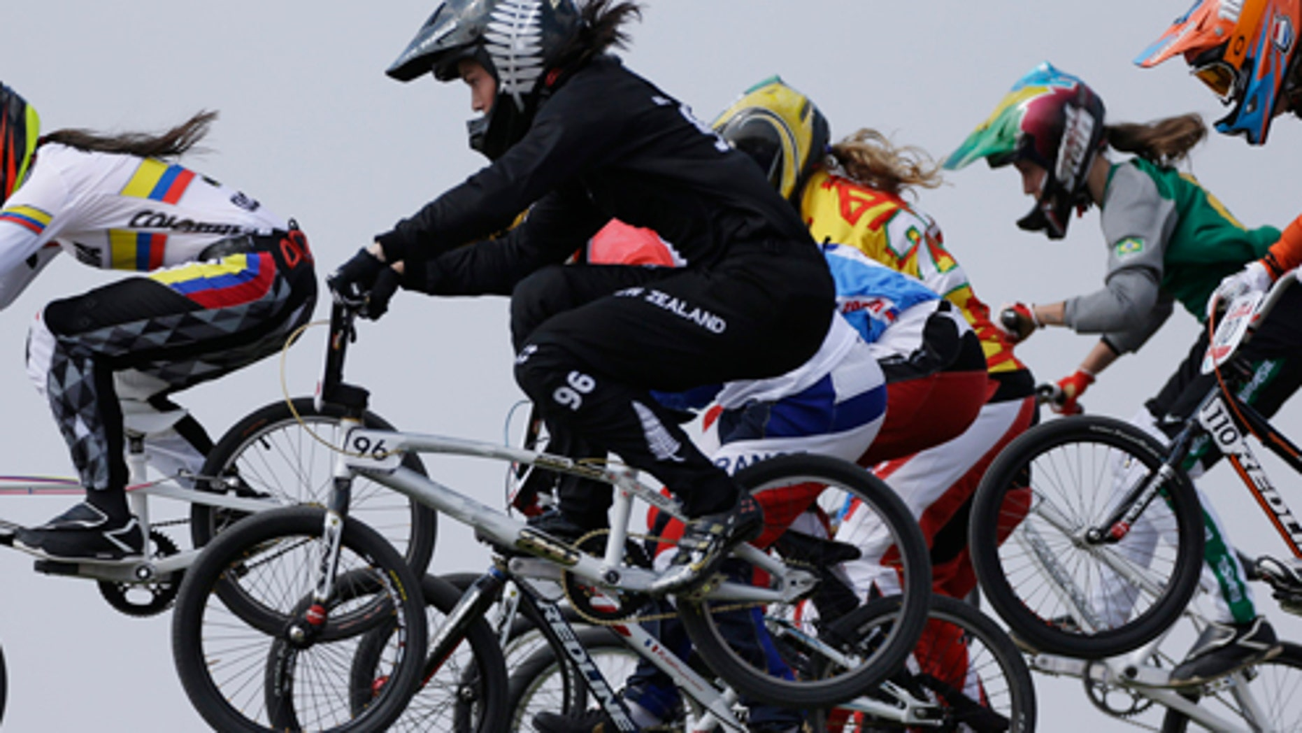 Colombia's Mariana Pajon (5) leads the competition in a BMX cycling women's semifinal run during the 2012 Summer Olympics, Friday, Aug. 10, 2012, in London. (AP Photo/Matt Rourke)
