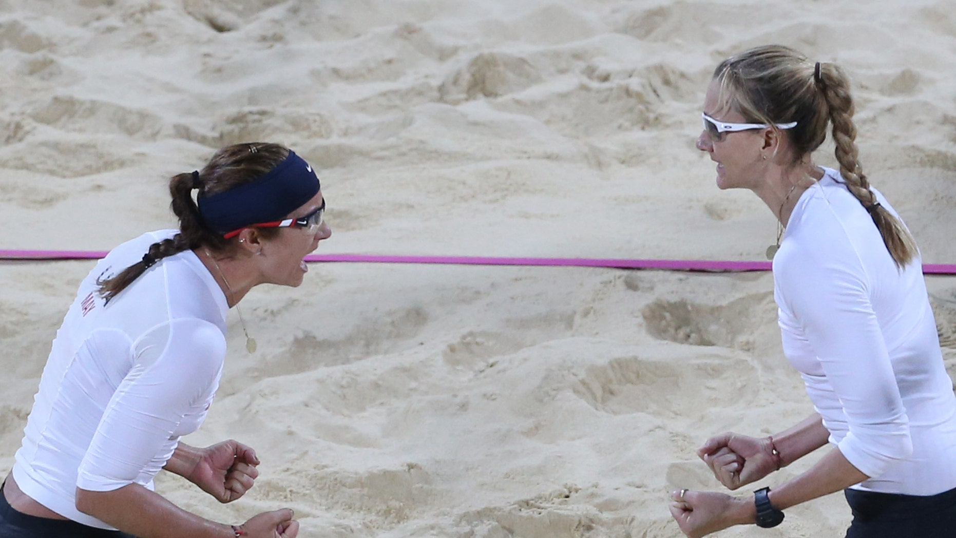 July 31, 2012: Kerri Walsh, right, and Misty May-Treanor, left, of US celebrate victory after their Beach Volleyball match against Czech Republic at the 2012 Summer Olympics in London.