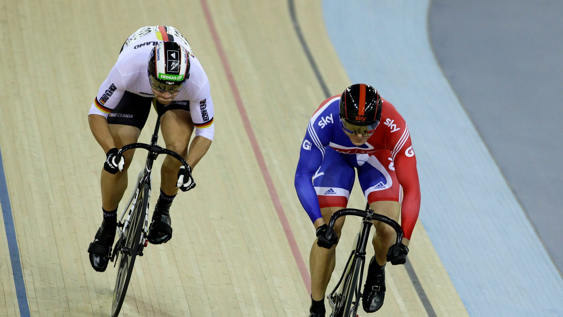 Feb. 19, 2012: In this file photo, gold medalist Britain's Chris Hoy, right, races silver medalist Germany's Maximilian Levy in their men's sprint race final during the World Cup track cycling meeting at the London 2012 Olympic Velodrome at the Olympic Park in London.