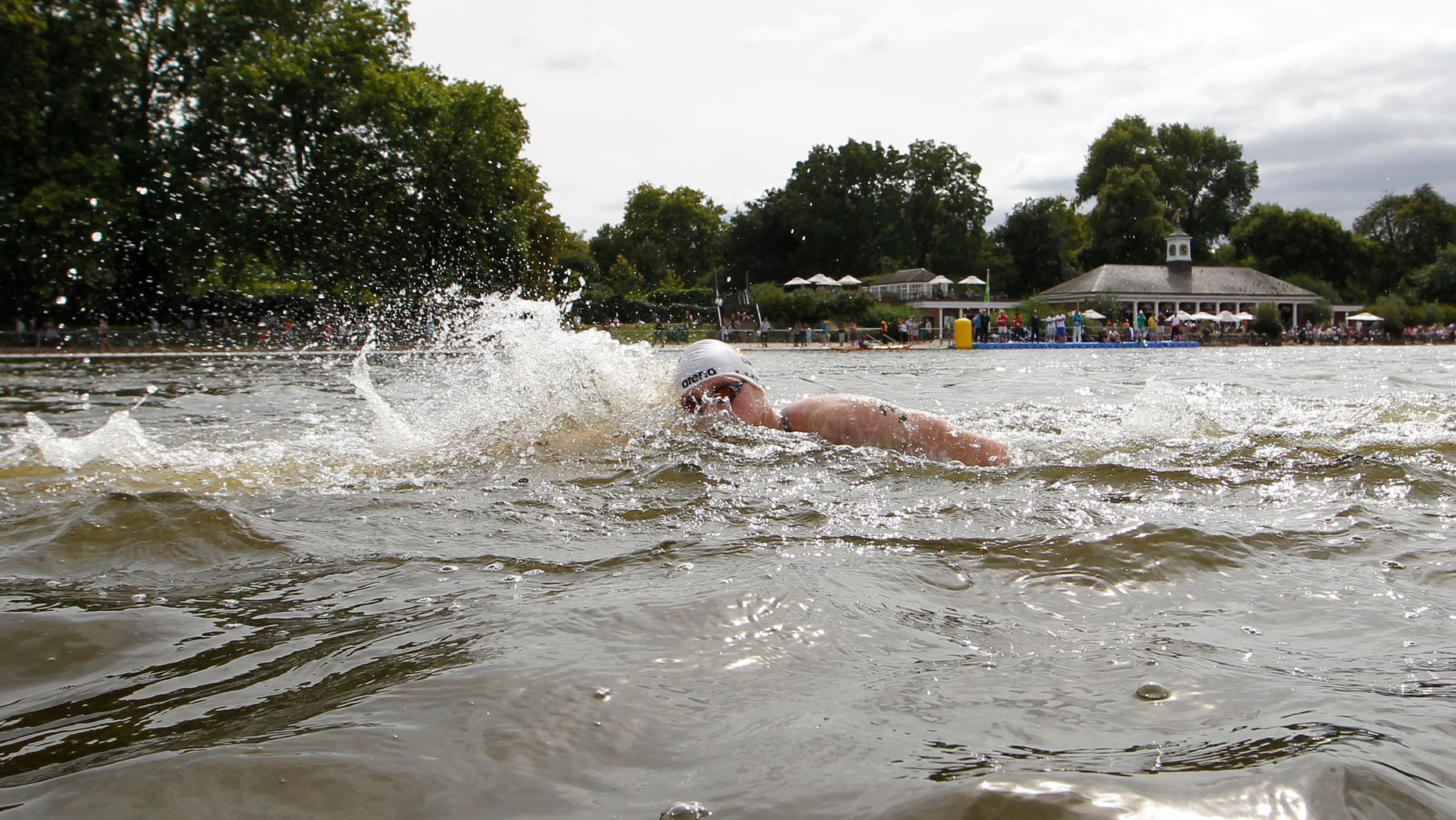 Aug. 13, 2011: In this file photo, Germany's Thomas Lurz races during the 10-kilometer marathon swimming International Olympic test event at Hyde Park's Serpentine lake in London.