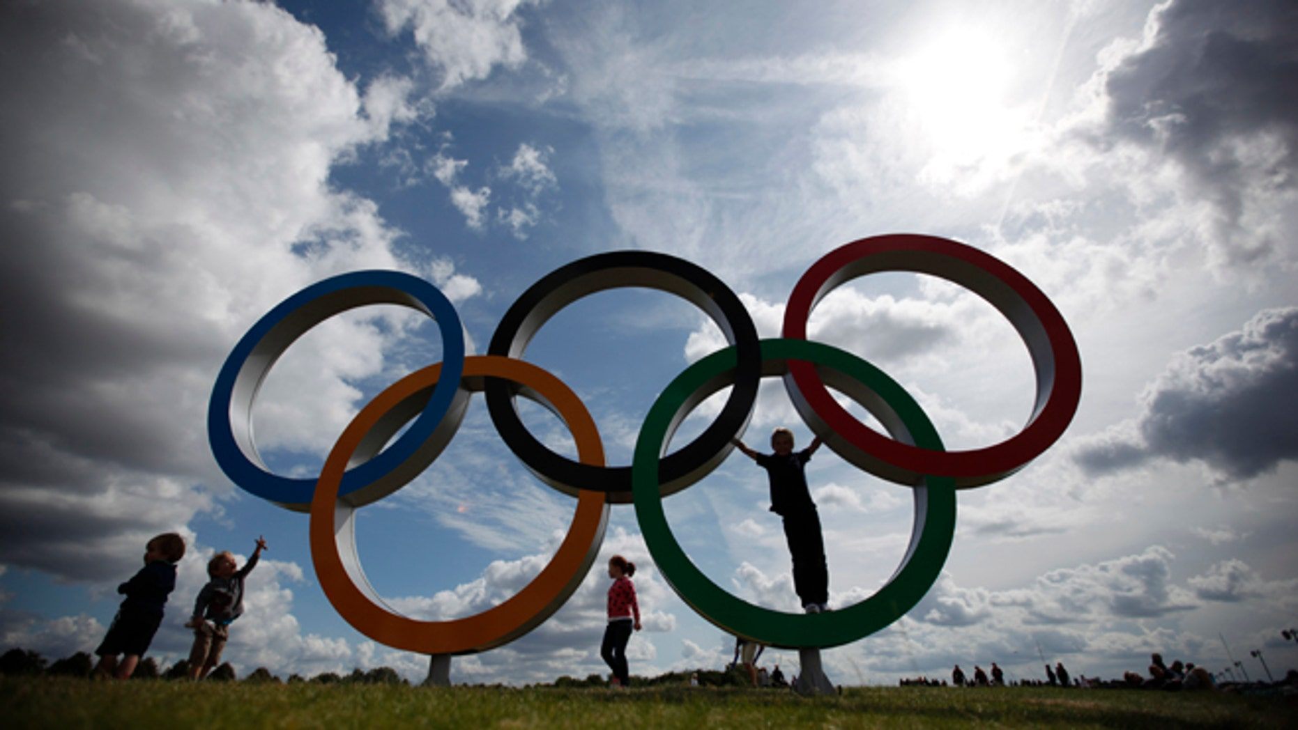 July 30, 2012: Children play on the Olympic rings at the rowing venue.