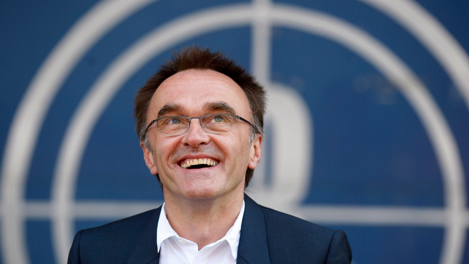 """June 17, 2012: This file photo shows Danny Boyle, the Oscar-winning director of """"Slumdog Millionaire"""" as he speaks to the media in east London after being appointed to oversee the opening ceremony of the 2012 London Olympics."""