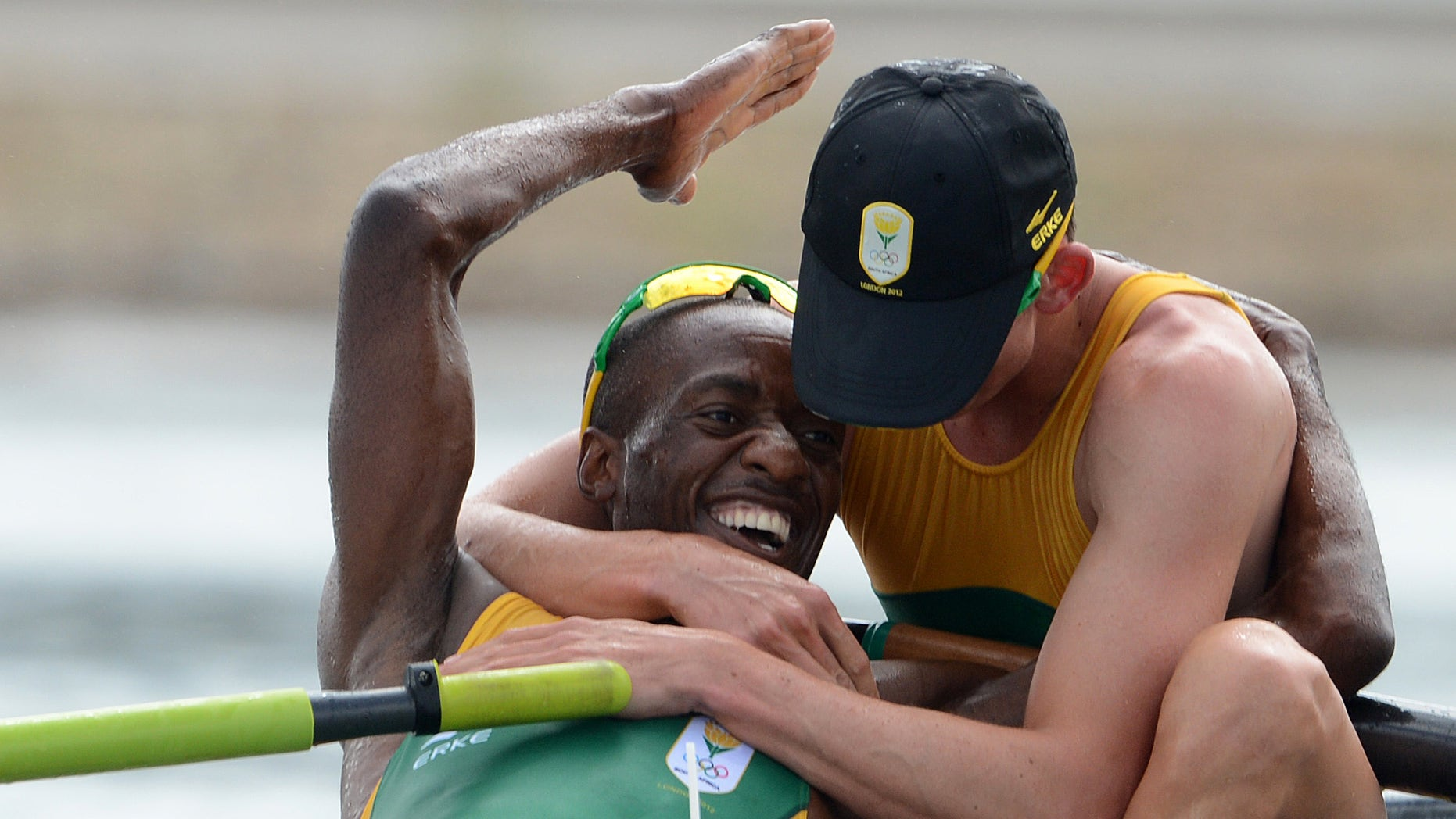 South Africa rowers Sizwe Ndlovu, left, and John Smith embrace after winning the gold medal in the men's lightweight four rowing final at the London 2012 Summer Olympics in Eton Dorney, near Windsor, England, on Thursday, Aug. 2, 2012. (AP Photo/Damien Meyer, Pool)