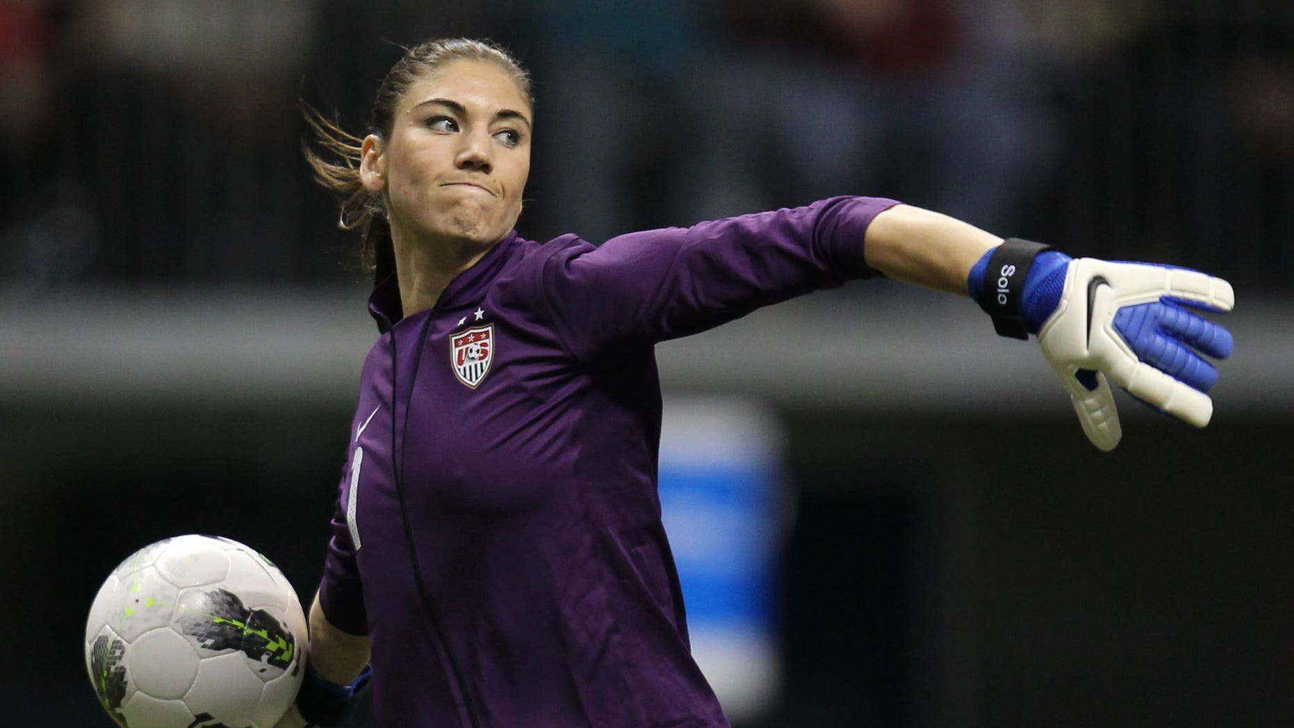 Jan. 27, 2012: In this file photo, United States goalkeeper Hope Solo (1) clears the ball from in front of her net during the second half against Costa Rica at the CONCACAF women's Olympic qualifying soccer game action at B.C. Place in Vancouver, Canada.