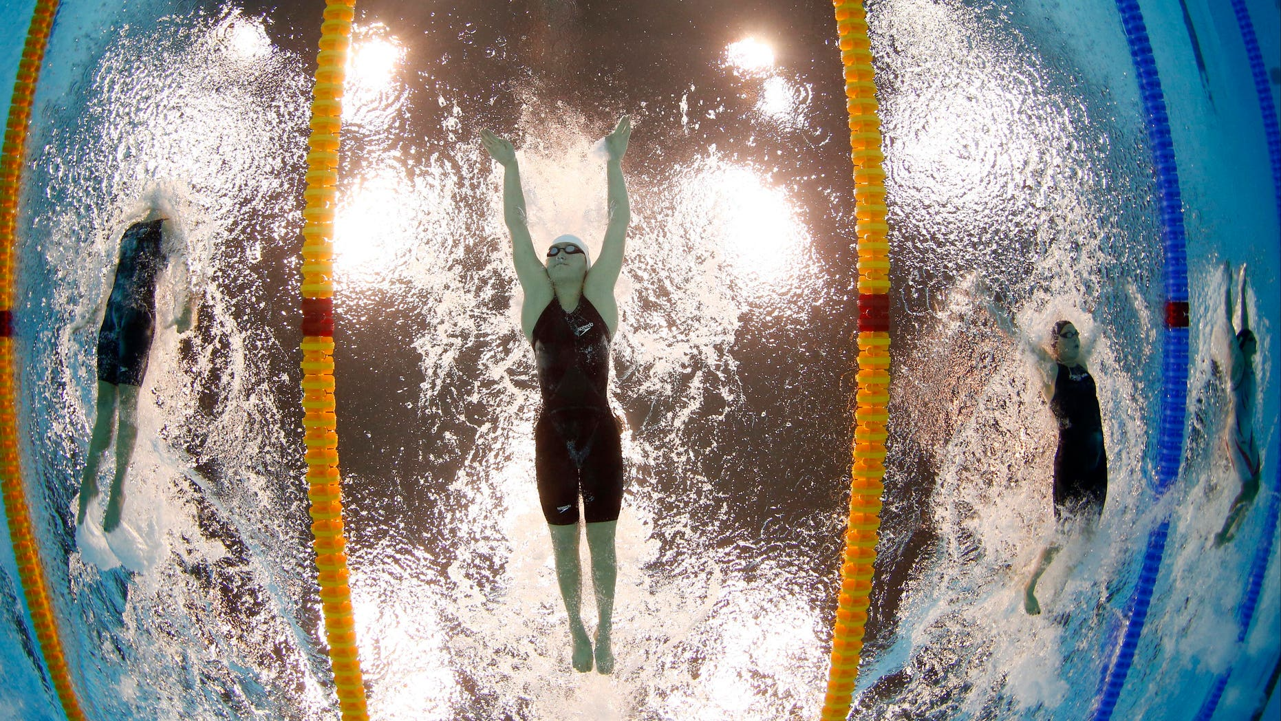 July 31, 2012: China's Ye Shiwen, center, competes in the  women's 200-meter individual medley swimming final at the Aquatics Centre in the Olympic Park during the 2012 Summer Olympics in London.