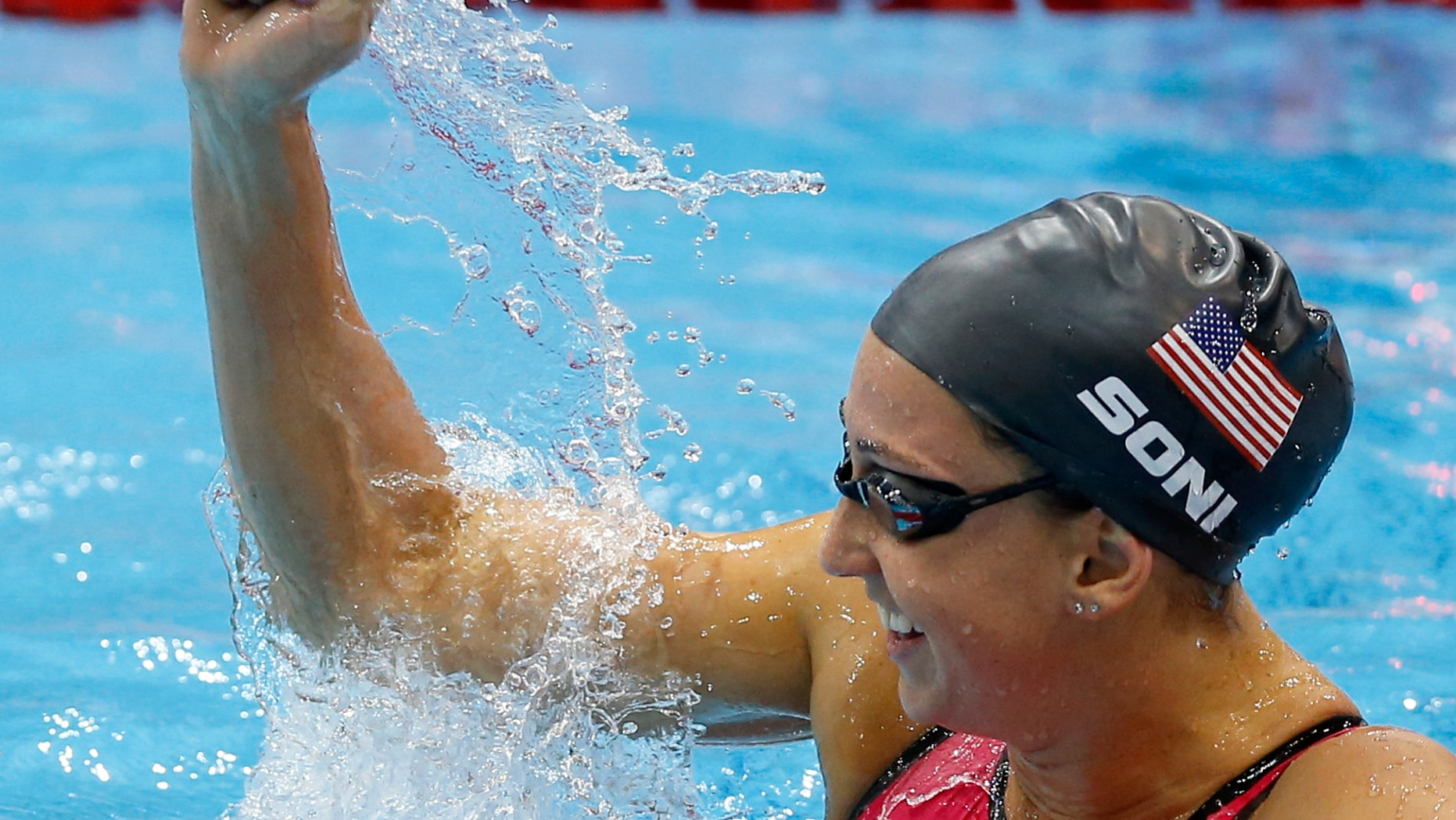 Aug. 2, 2012: United States' Rebecca Soni celebrates her gold medal win in the women's 200-meter breaststroke swimming final at the Aquatics Centre in the Olympic Park during the 2012 Summer Olympics in London.