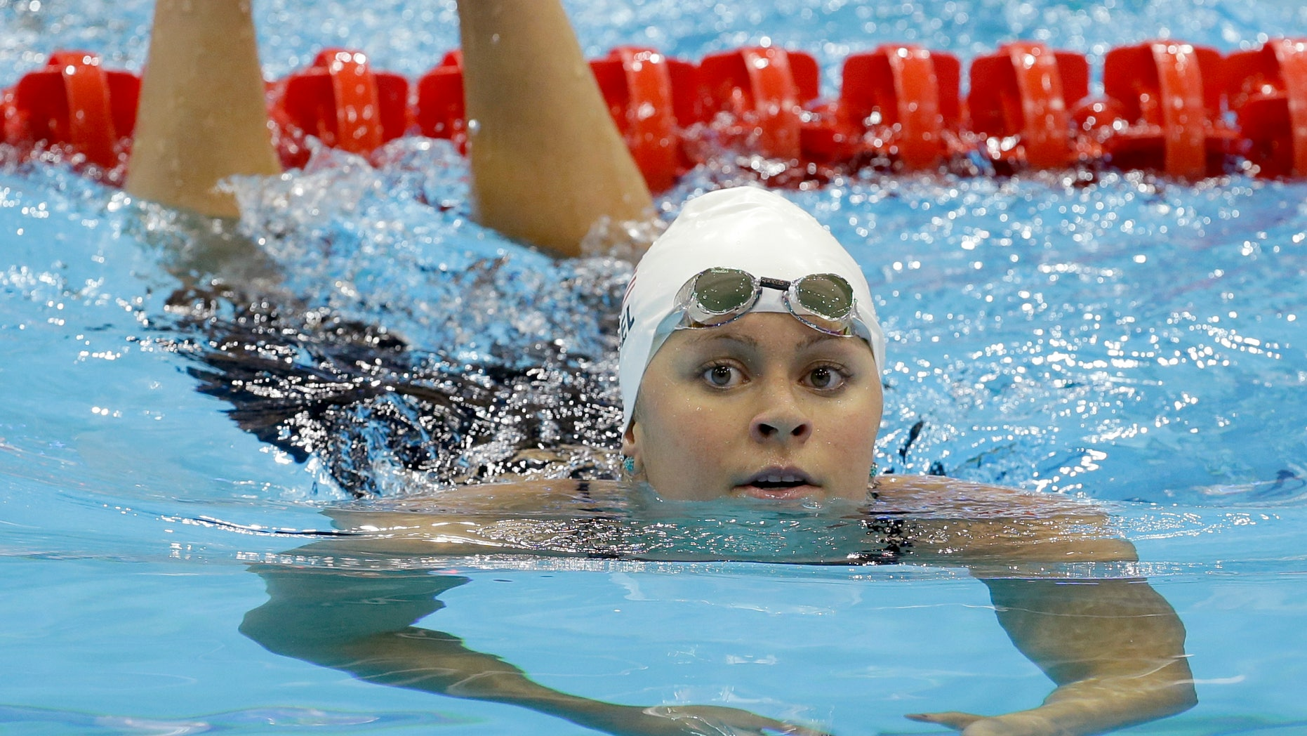 United States' Elizabeth Beisel reacts after competing in a women's 200-meter backstroke swimming heat at the Aquatics Centre in the Olympic Park during the 2012 Summer Olympics in London, Thursday, Aug. 2, 2012. (AP Photo/Lee Jin-man)