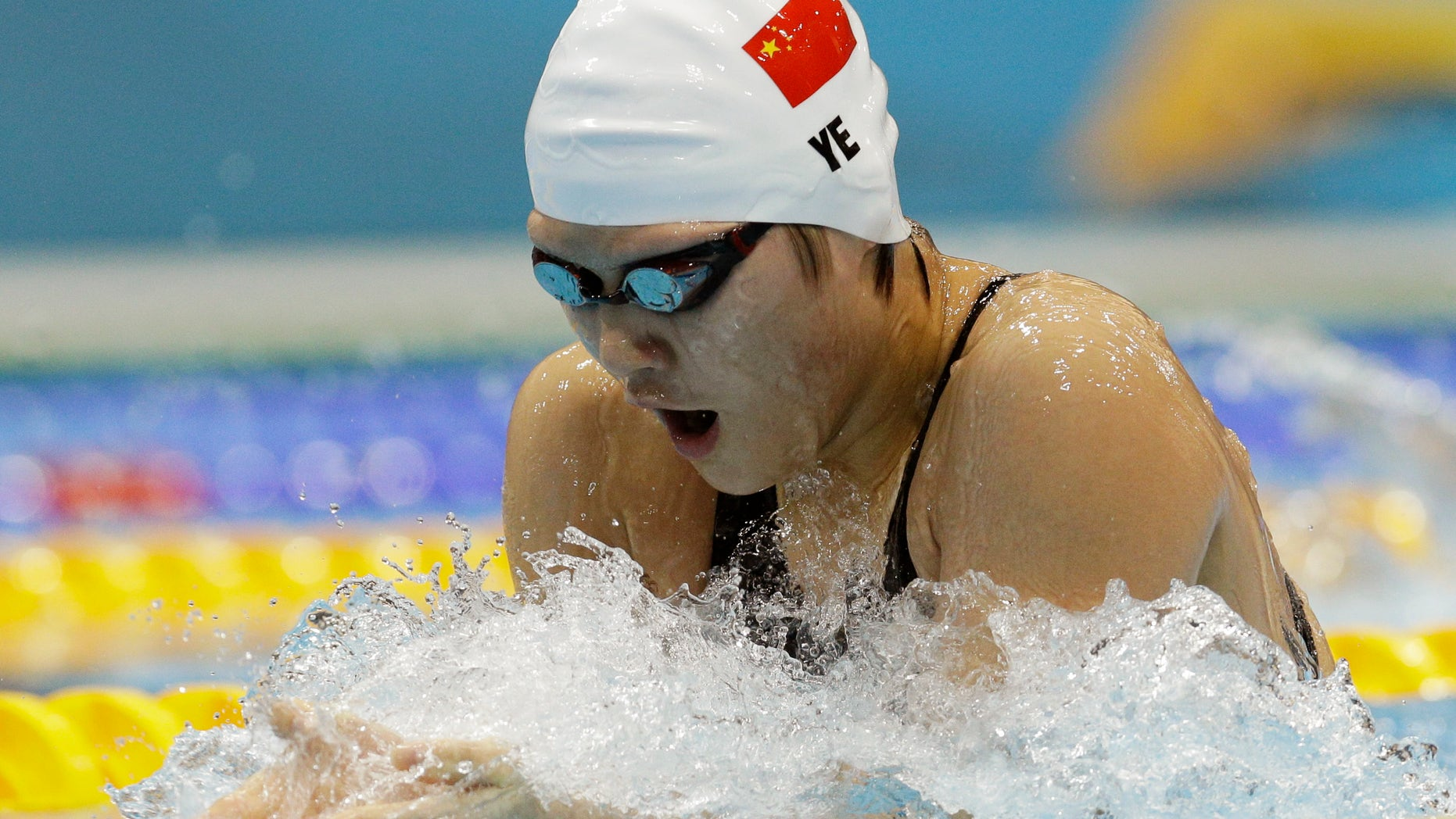 China's Ye Shiwen competes in a women's 200-meter individual medley swimming heat at the Aquatics Centre in the Olympic Park during the 2012 Summer Olympics in London, Monday, July 30, 2012. (AP Photo/Michael Sohn)