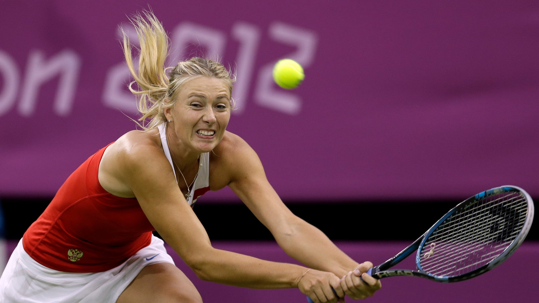 July 29, 2012: Maria Sharapova of Russia returns to Shahar Peer of Israel at the All England Lawn Tennis Club in Wimbledon, London at the 2012 Summer Olympics.