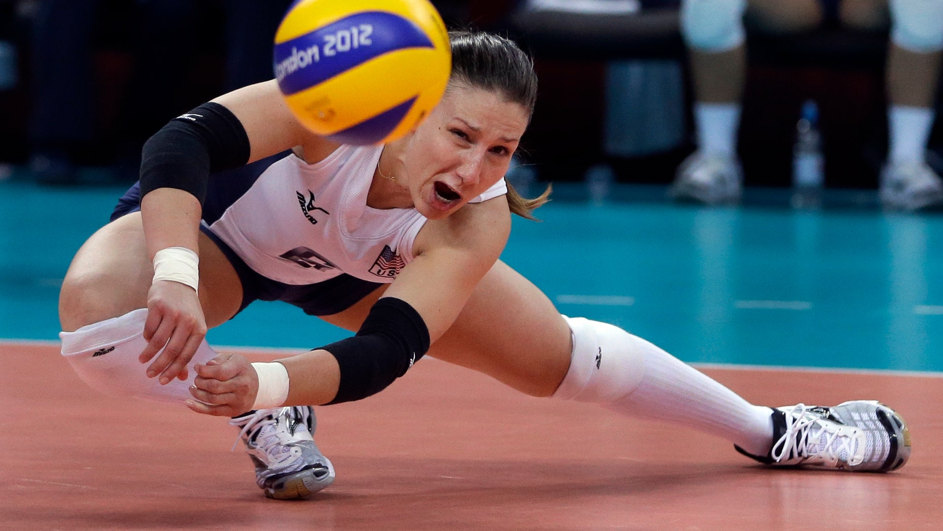 United States' Nicole Davis reaches for the ball during a women's preliminary volleyball match against Brazil at the 2012 Summer Olympics, Monday, July 30, 2012, in London. (AP Photo/Jeff Roberson)
