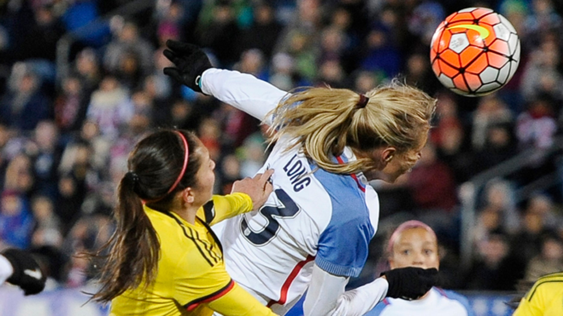 United States Allie Long, scores a goal as Colombia's Natalia Gaitan, left, defends during the first half of an international friendly soccer match Wednesday, April 6, 2016, in East Hartford, Conn.