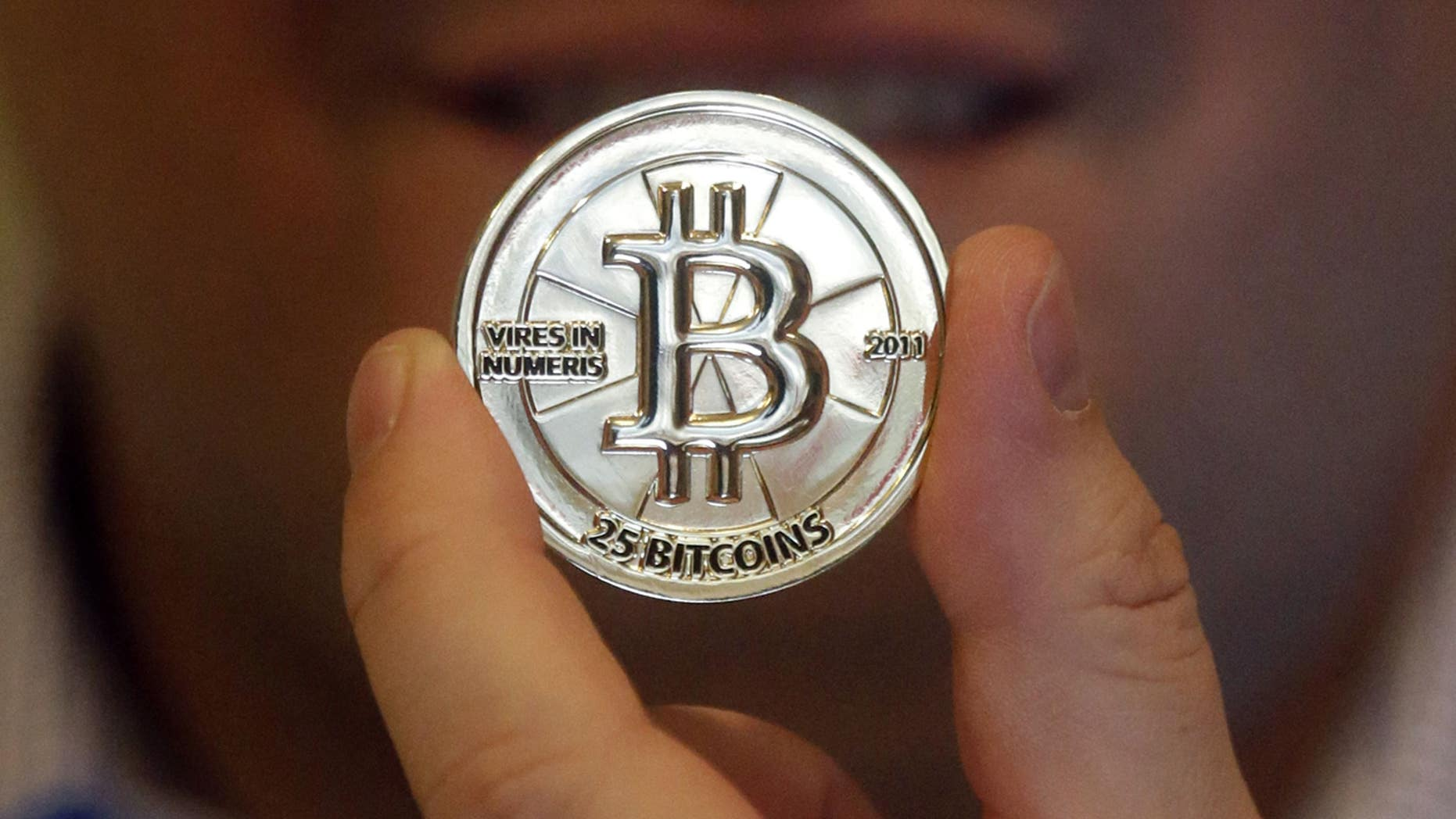 A 25 Bitcoin token is seen in Sandy, Utah.