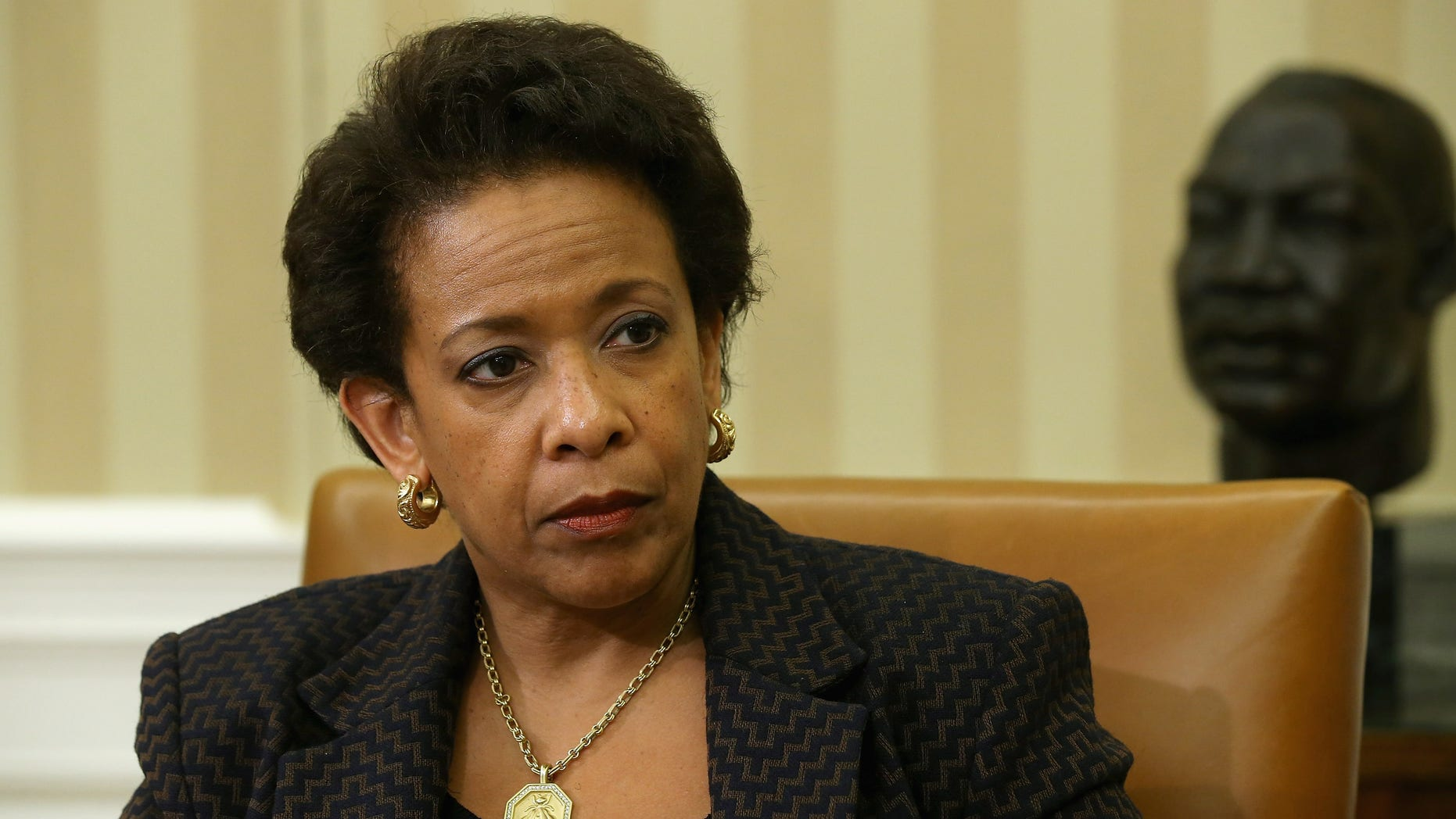 WASHINGTON, DC - MAY 29:  U.S. Attorney General Loretta Lynch listens to President Barack Obama as he delivers remarks to reporters after a meeting in the Oval Office at the White House May 29, 2015 in Washington, DC. The first African-American woman to head the Justice Department, Lynch announced this week a major corruption investigation into FIFA, the world's largest soccer organizing body.  (Photo by Chip Somodevilla/Getty Images)