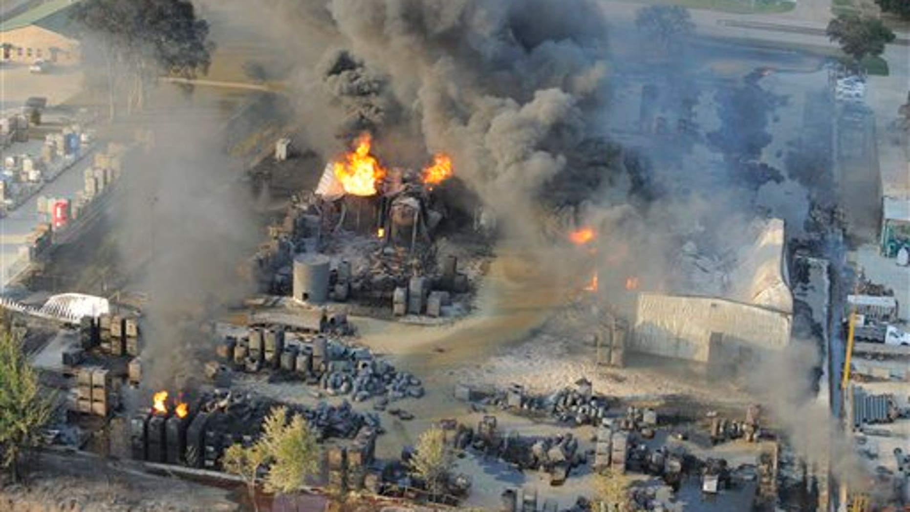 June 14: An aerial view of the fire raging at Multi-Chem Corp. near Acadiana Regional Airport in New Iberia, La.
