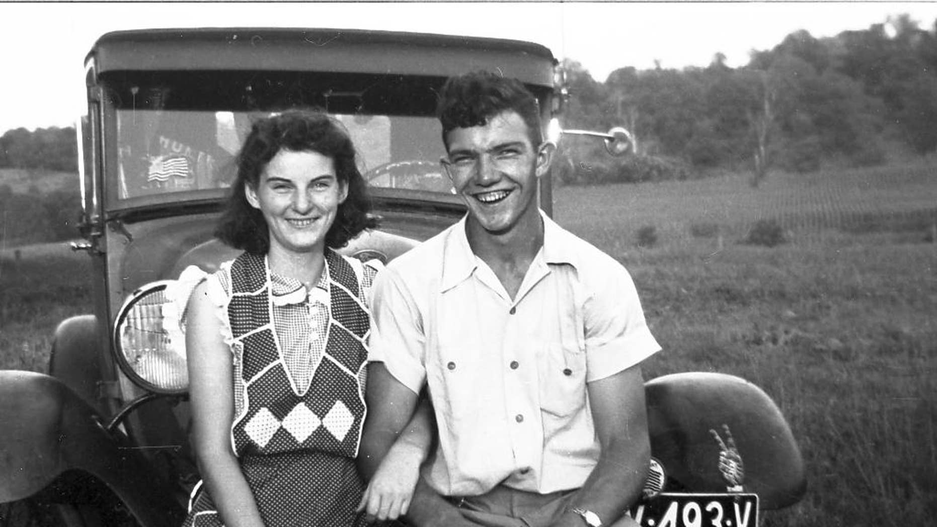 In this September 1941 photo provided by Dick Felumlee, Kenneth and Helen Felumlee pose for a photo nearly three years before their marriage in February 1944. The Felumlees, who celebrated their 70th wedding anniversary in February, died 15 hours apart from each other last week. (AP Photo/Felumlee family)