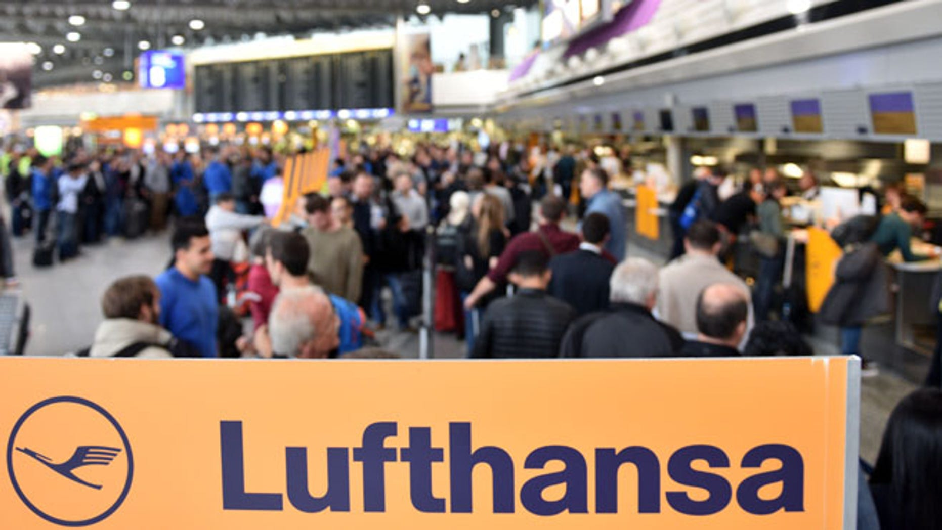 FRANKFURT AM MAIN, GERMANY - NOVEMBER 06:  Passengers of the German airline Lufthansa wait at terminal 1 at Frankfurt Airport during an strike over salaries at Frankfurt and Dusseldorf airports on November 6, 2015 in Frankfurt, Germany. The UFO labor union, which represents the crews, has resorted to the strike following failed negotiations with Lufthansa and is leaving the option open for further strikes in coming days.  (Photo by Thomas Lohnes/Getty Images)