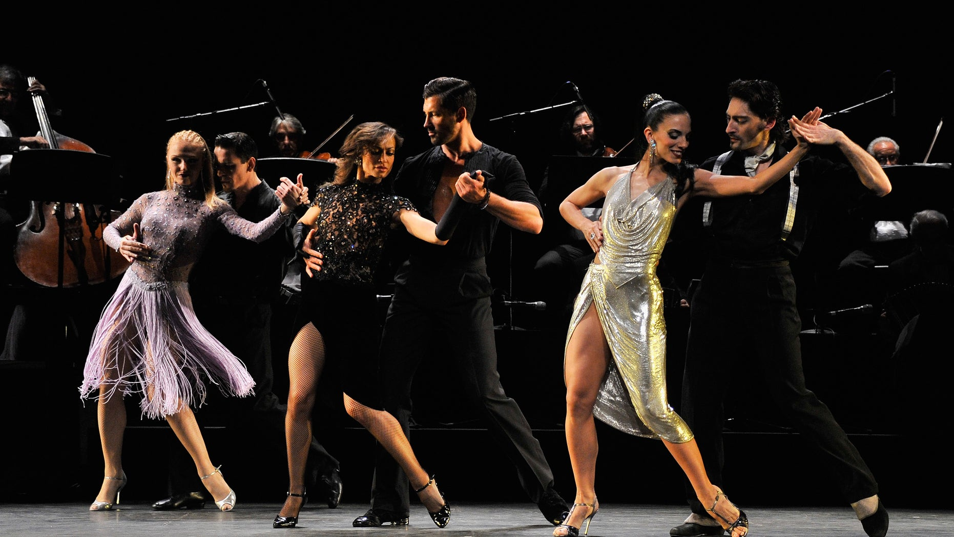 """NEW YORK, NY - JULY 11:  (L-R)  Dancers Soledad Buss, Cesar Peral, Karina Smirnoff, Maksim Chmerkovskiy, Victoria Galoto, and Juan Paulo Horvath perform at the """"Forever Tango"""" Press Preview at Walter Kerr Theatre on July 11, 2013 in New York City.  (Photo by Stephen Lovekin/Getty Images)"""