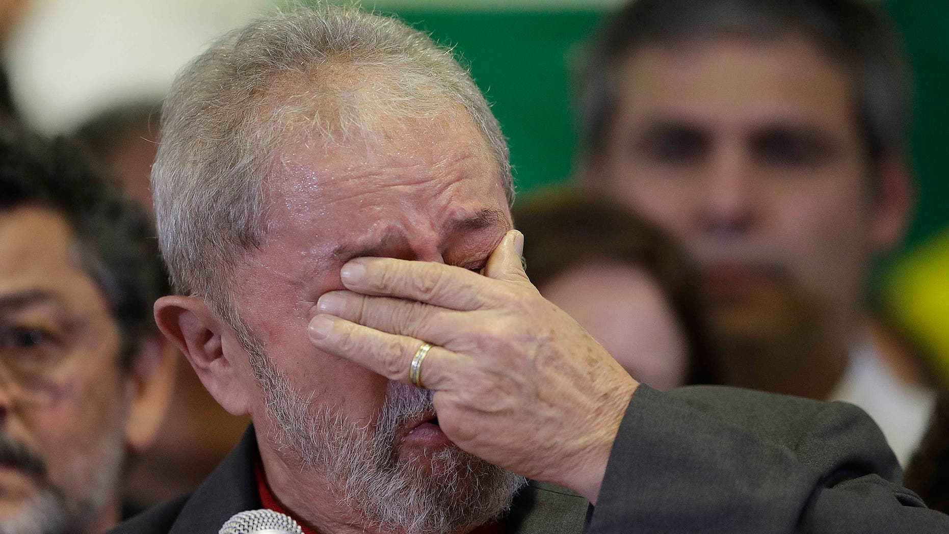 Lula da Silva weeps during a news conference on the corruption charges he is facing, on Thursday, Sept. 15, 2016.