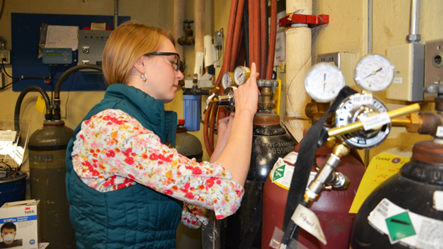Gretchen Buttorf,  an Aerospace Engineering junior at Penn St., tests a student-designed rocket engine test rig for the Lunar Lion moonlander.