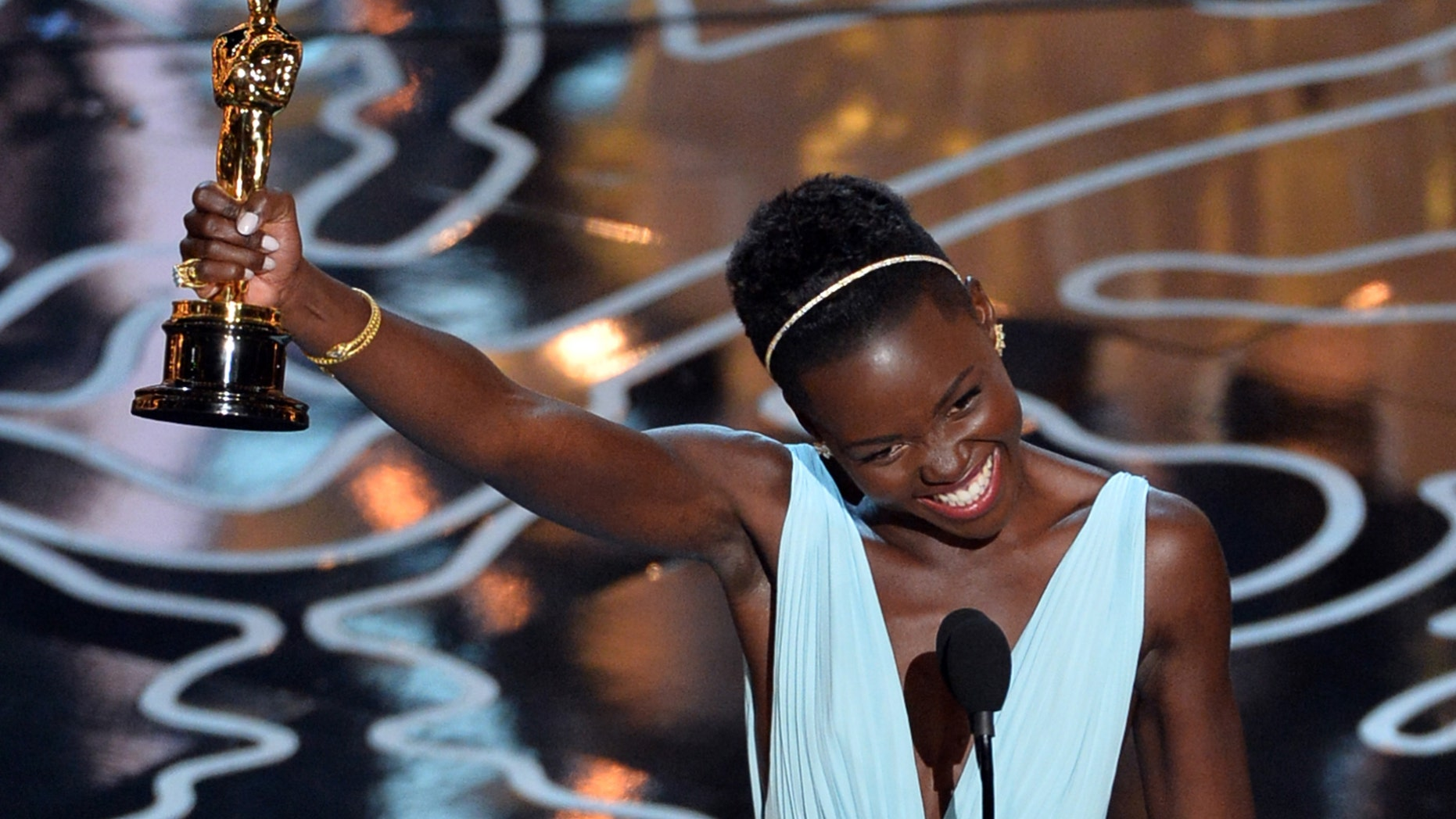 HOLLYWOOD, CA - MARCH 02:  Actress Lupita Nyong'o accepts the Best Performance by an Actress in a Supporting Role award for '12 Years a Slave' onstage during the Oscars at the Dolby Theatre on March 2, 2014 in Hollywood, California.  (Photo by Kevin Winter/Getty Images)