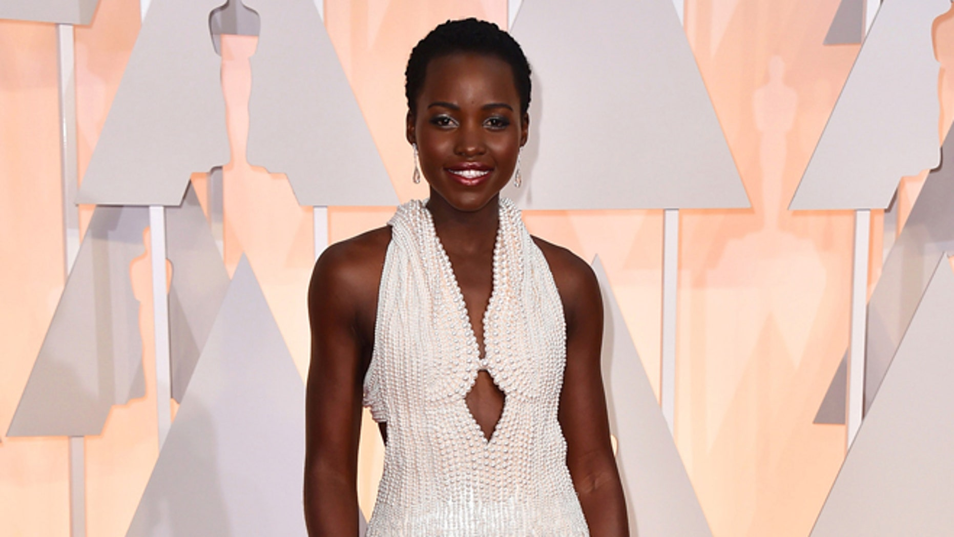 Lupita Nyong'o arrives at the Oscars at the Dolby Theatre in Los Angeles on Feb. 22, 2015 file photo,.