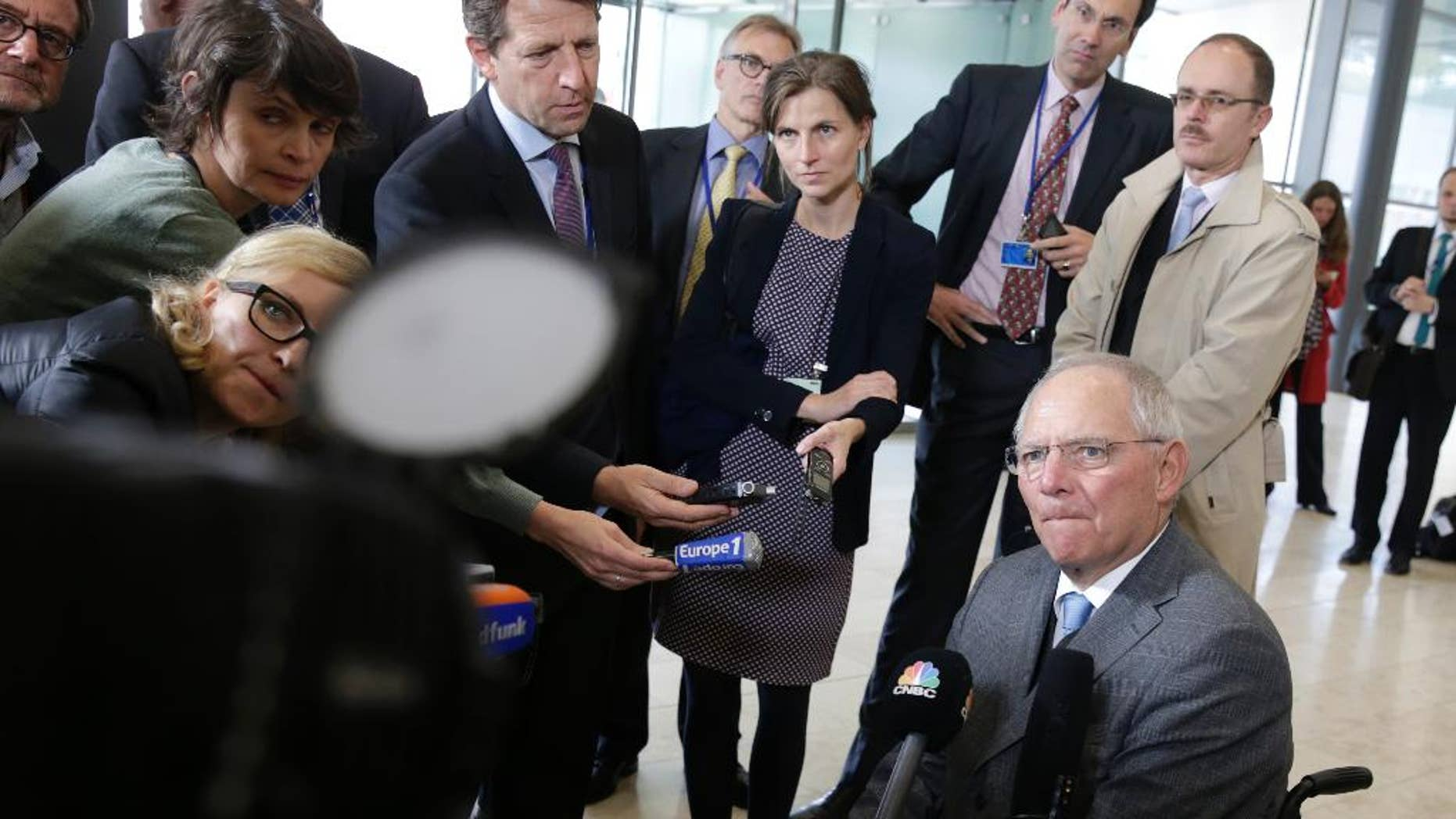 German Finance Minister Wolfgang Schaeuble talks with the media prior to the Eurogroup finance ministers meeting in Luxembourg, Monday Oct. 13, 2014. Finance ministers from the nations sharing the euro currency meet ahead of Tuesday's EU finance ministers council. (AP Photo/Yves Logghe)