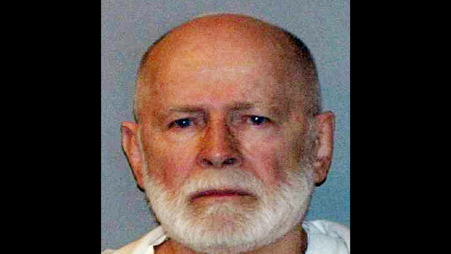 "This June 23, 2011 booking photo provided by the U.S. Marshals Service shows James""Whitey"" Bulger, who fled Boston in 1994 and wasn't captured until 2011 in Santa Monica, Calif., after 16 years on the run."