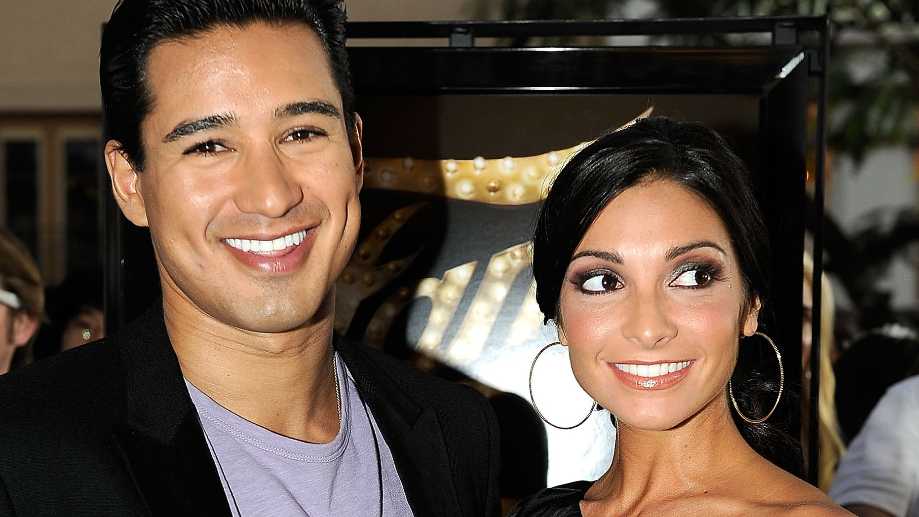 """LOS ANGELES, CA - SEPTEMBER 23:  Actor Mario Lopez and Courtney Mazza arrive at the premiere of MGM Pictures' """"Fame"""" at the Pacific Grove Theaters on September 23, 2009 in Los Angeles, California.  (Photo by Alberto E. Rodriguez/Getty Images)"""