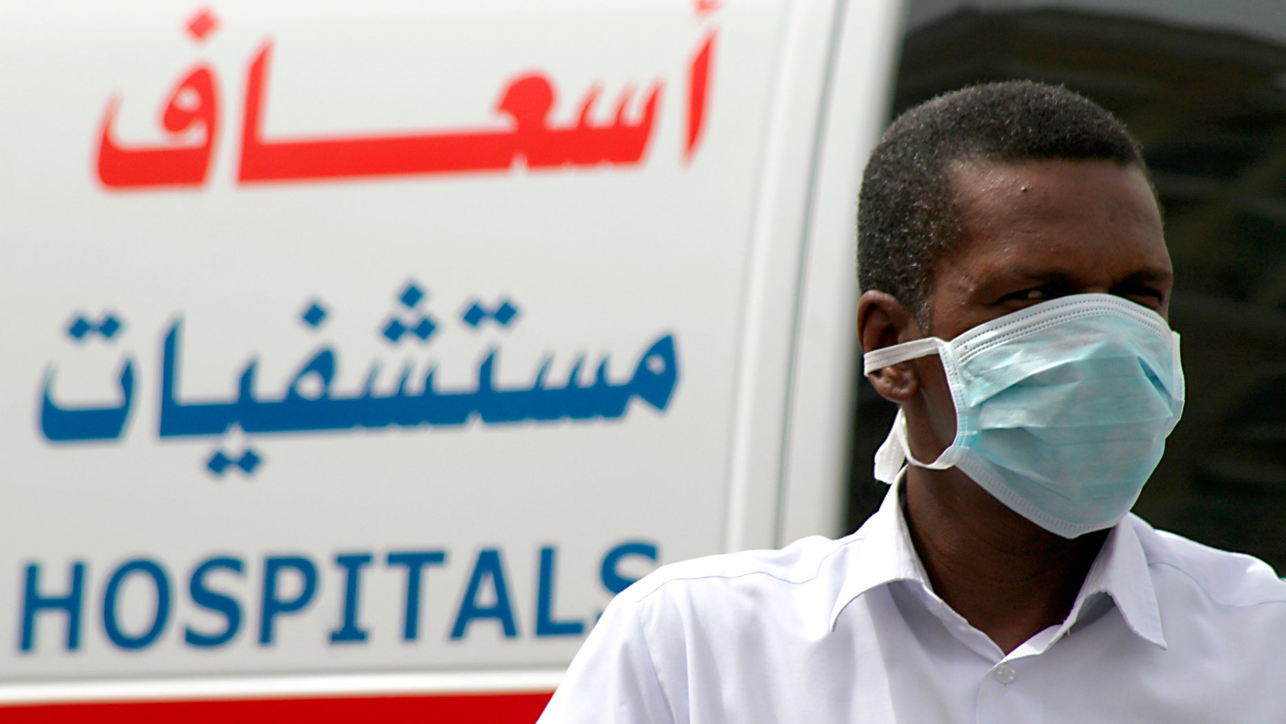 A man, wearing a surgical mask as a precautionary measure against the novel coronavirus, walks near a hospital in Khobar city in Dammam.