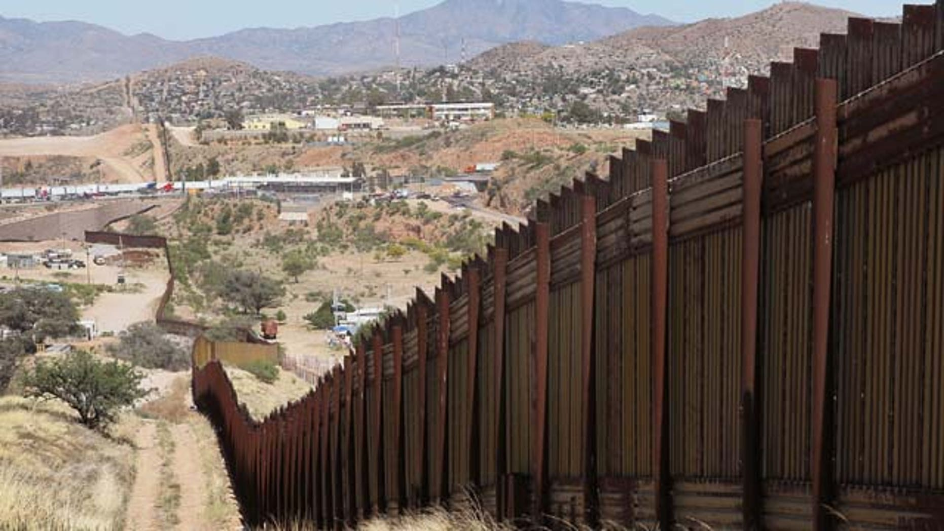 June 02, 2010:  A fence separates the cities of Nogales, Arizona (L) and Nogales, Sonora Mexico, a frequent crossing point for people entering the United States illegally in Nogales, Arizona.