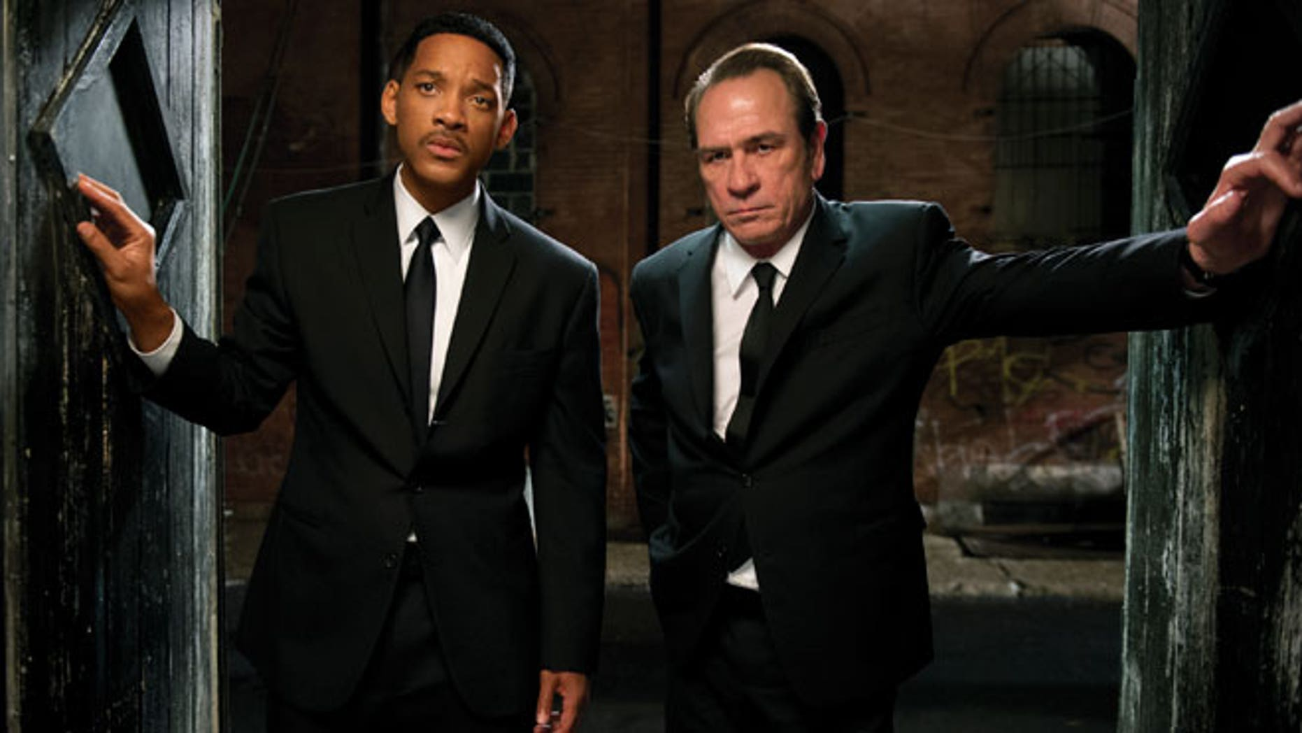 "In this film image released by Sony Pictures, Tommy Lee Jones, right, and Will Smith star are shown in a scene from ""Men in Black 3."""