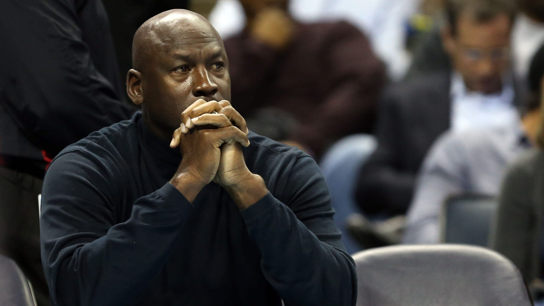 CHARLOTTE, NC - JANUARY 15:  Michael Jordan, owner of the Charlotte Bobcats watches on during their game against the Indiana Pacers at Time Warner Cable Arena on January 15, 2013 in Charlotte, North Carolina.  NOTE TO USER: User expressly acknowledges and agrees that, by downloading and or using this photograph, User is consenting to the terms and conditions of the Getty Images License Agreement.  (Photo by Streeter Lecka/Getty Images)