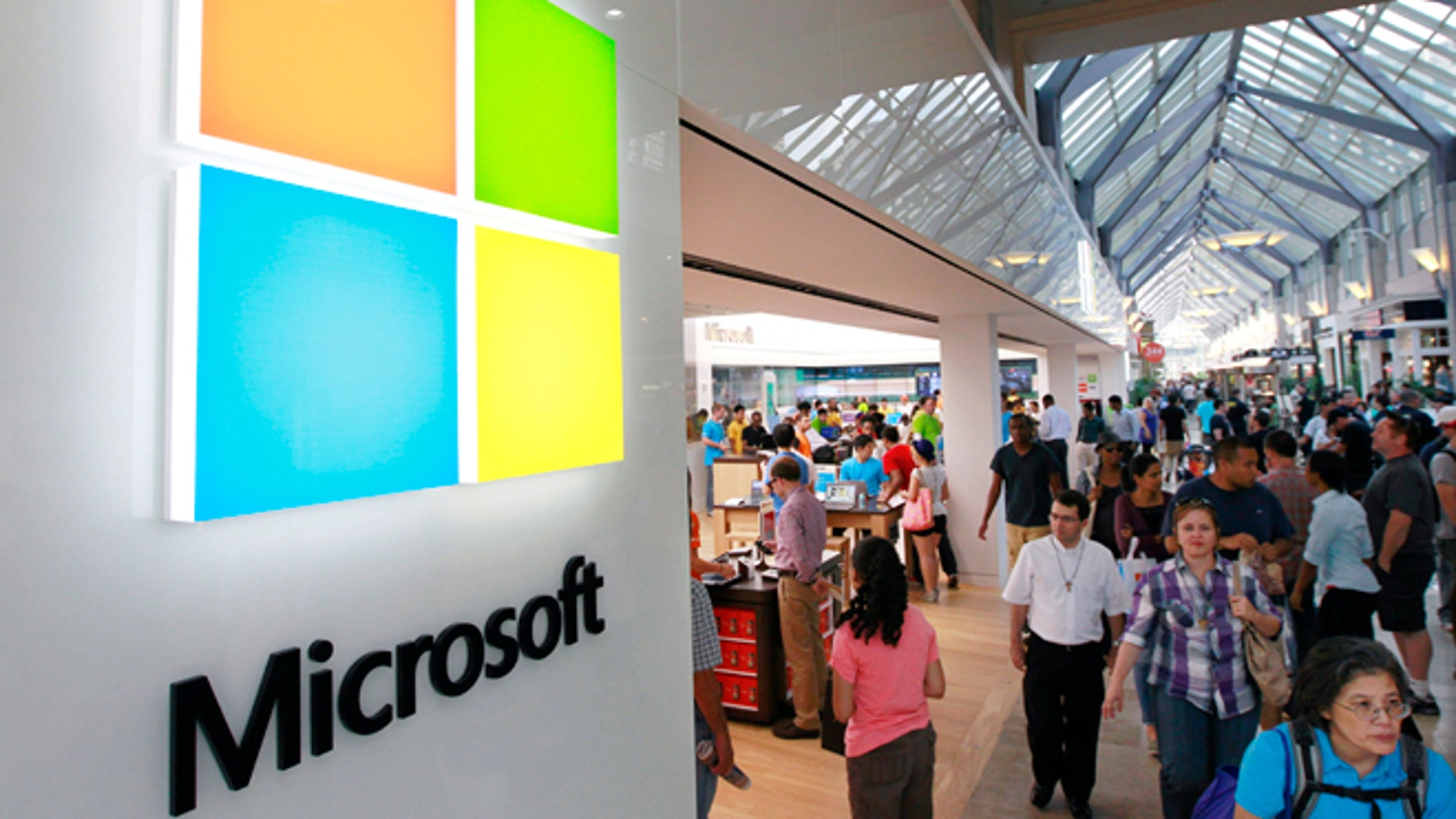 FILE photo: - In this Thursday, Aug. 23, 2012 file photo, the Microsoft Corp. logo, left, is seen on an exterior wall of a new Microsoft store inside the Prudential Center mall, in Boston.  (AP Photo/Steven Senne, File)