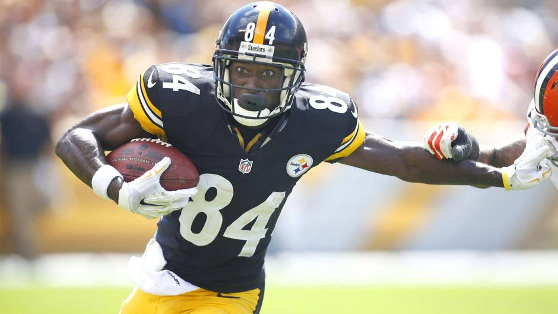 Sep 7, 2014; Pittsburgh, PA, USA; Pittsburgh Steelers wide receiver Antonio Brown (84) runs after a pass reception against the Cleveland Browns during the second quarter at Heinz Field. Mandatory Credit: Charles LeClaire-USA TODAY Sports