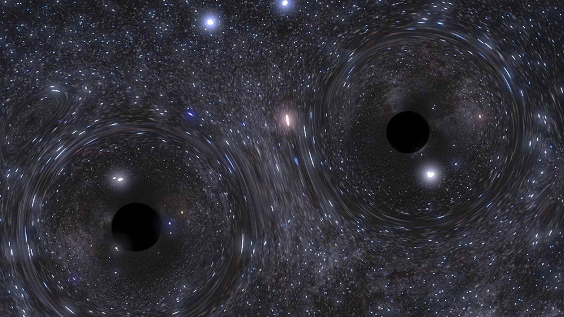 A snapshot of a simulation showing the binary black hole formed in the heart of a dense cluster of stars.