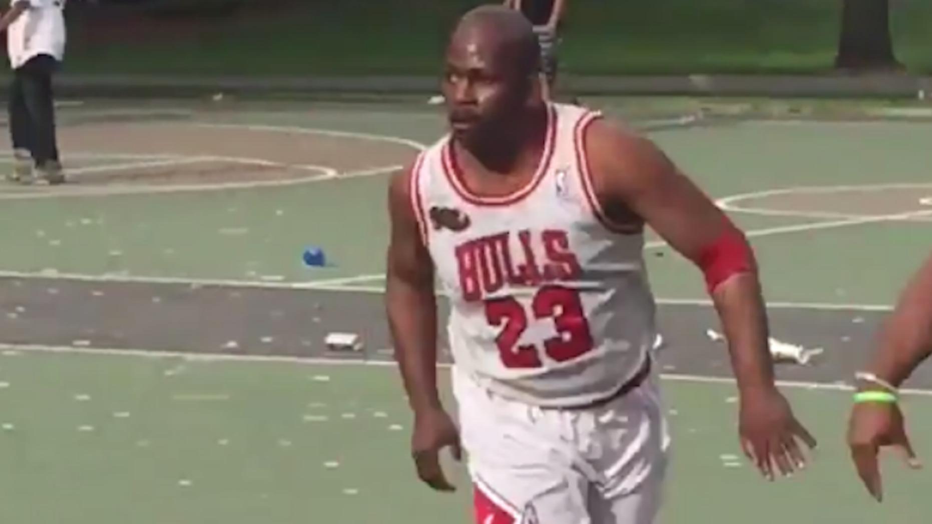 buy popular c3a76 daf3f Wannabe Michael Jordan wears full uniform during pick-up ...