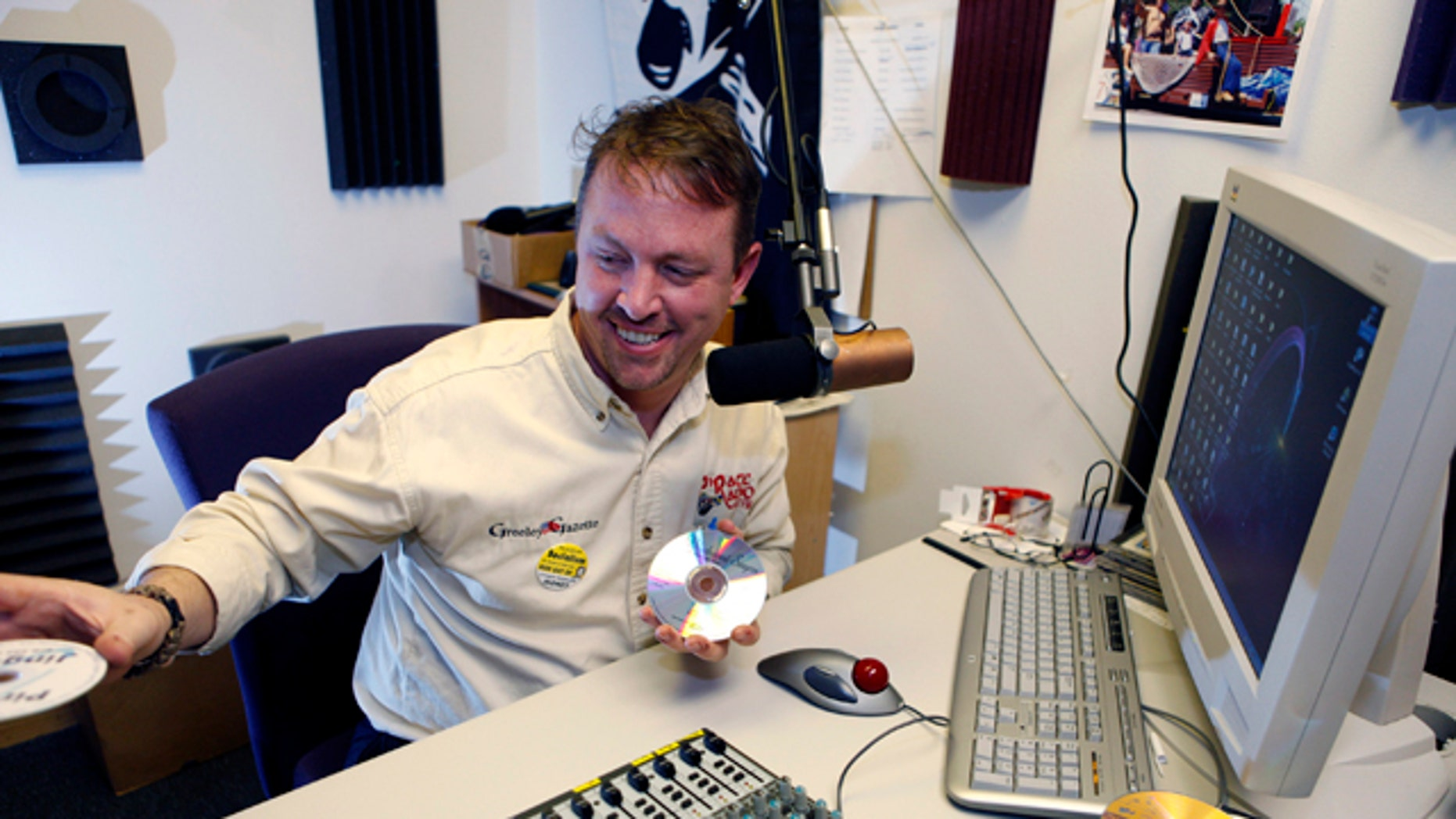 Jan. 14, 2011: Brett Reese is pictured at the controls in the studio of his radio station in Greeley, Colo.