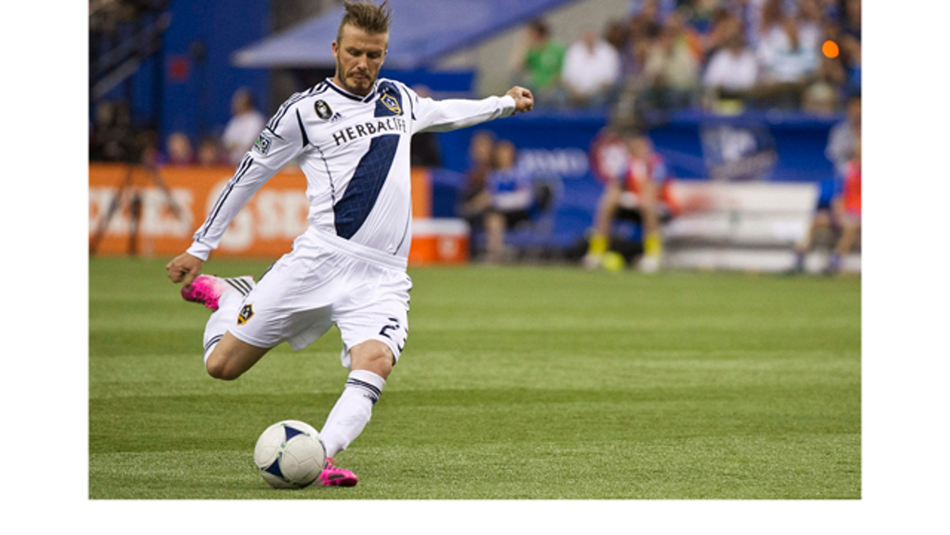 May 12, 2012: Los Angeles Galaxy's David Beckham scores a goal against the Montreal Impact during the second half of an MLS soccer match in Montreal.
