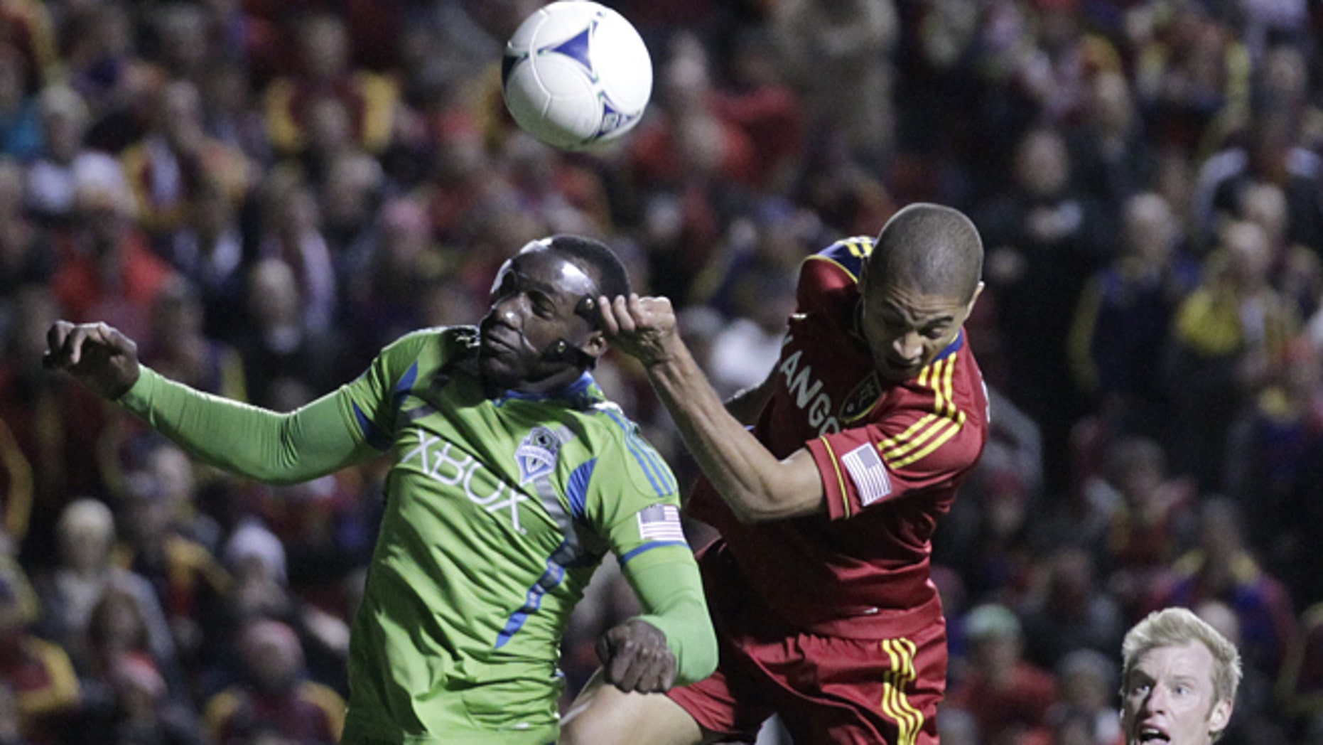Seattle Sounders defender Jhon Kennedy Hurtado (34) heads the ball as Real Salt Lake forward Alvaro Saborio (15) defends in the second half during an MLS Western Conference semifinal soccer match Thursday, Nov. 8, 2012, in Sandy, Utah. The Sounders defeated Real Salt Lake. The match, the second of a two-match aggregate game, ended with a score of 1-0.  (AP Photo/Rick Bowmer)