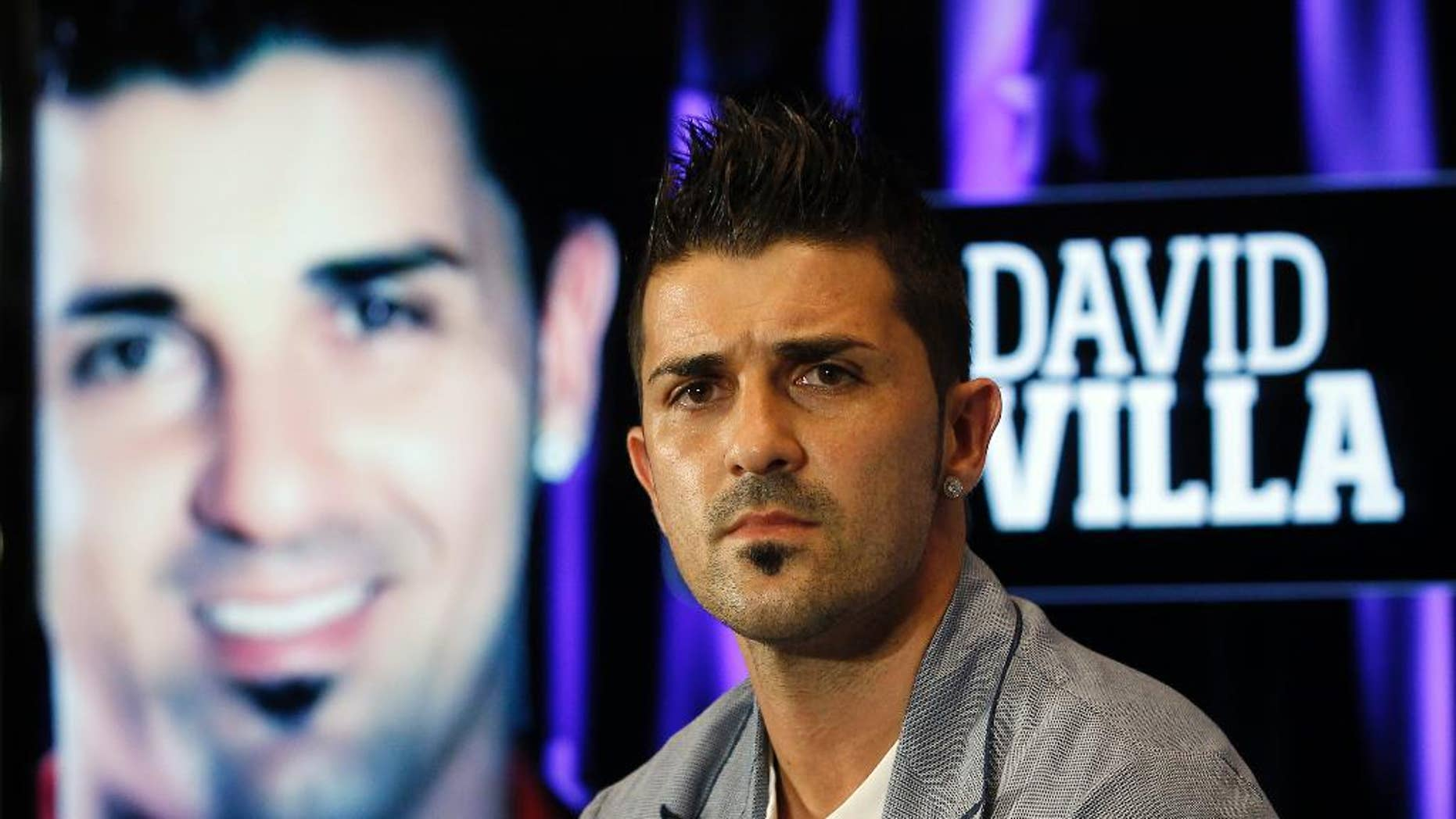 FILE - This is a July 15, 2013 file photo showing Atletico de Madrid's soccer player  David Villa during his presentation at the Vicente Calderon Stadium in Madrid. Villa has signed a three-year contract with New York City FC, becoming the first player on the expansion Major League Soccer team that starts play next season. (AP Photo/Andres Kudacki, File)