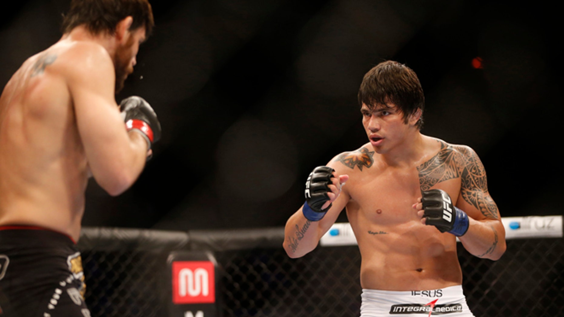 Oct.14, 2012: In this file photo, Erick Silva, right, from Brazil, fights Jon Fitch, left, from the United States, during their welterweight mixed martial arts bout at the Ultimate Fighting Championship (UFC) 153 in Rio de Janeiro, Brazil.