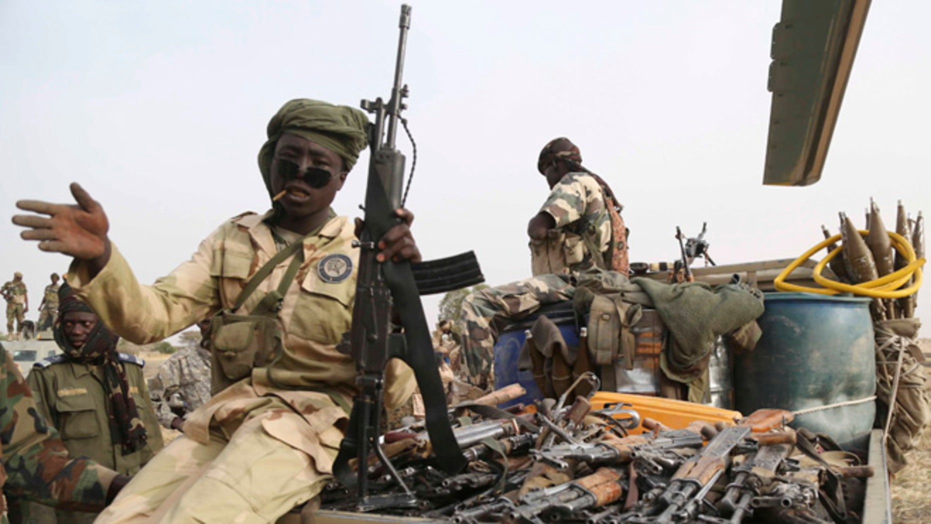 March 18, 2015:Chadian soldiers carry weapons captured from Boko Haram in a pickup truck in the recently retaken town of Damasak, Nigeria.  (REUTERS/Emmanuel Braun)