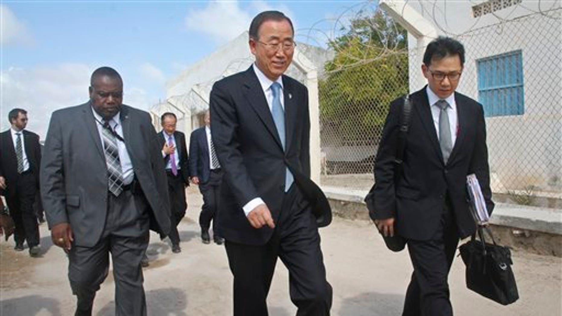 U.N. Secretary General Ban Ki-moon, center, walks inside the heavily-protected airport complex during a visit to Mogadishu, Somalia, Wednesday, Oct. 29, 2014.  (AP Photo/Farah Abdi Warsameh)