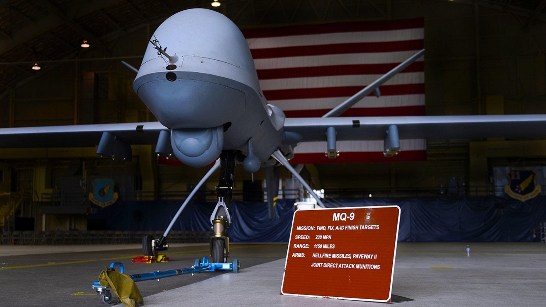 The MQ-9 Reaper drone waits in a hangar at Joint Base Elmendorf-Richardson, Alaska.